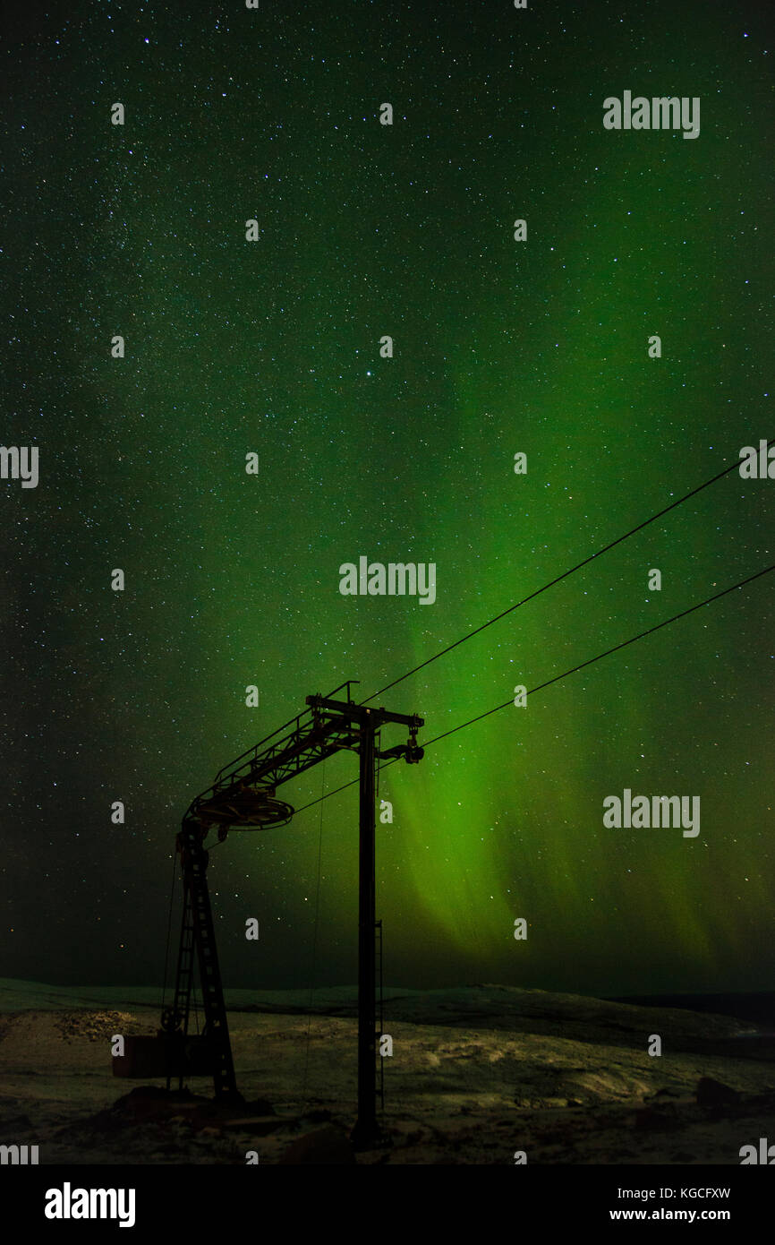 Swirling illumination above arctic winter night sky - Stock Image