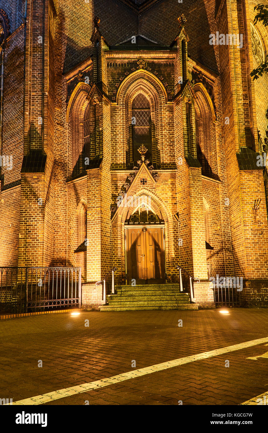 The Facade Of Gothic Church By Night In Poznan