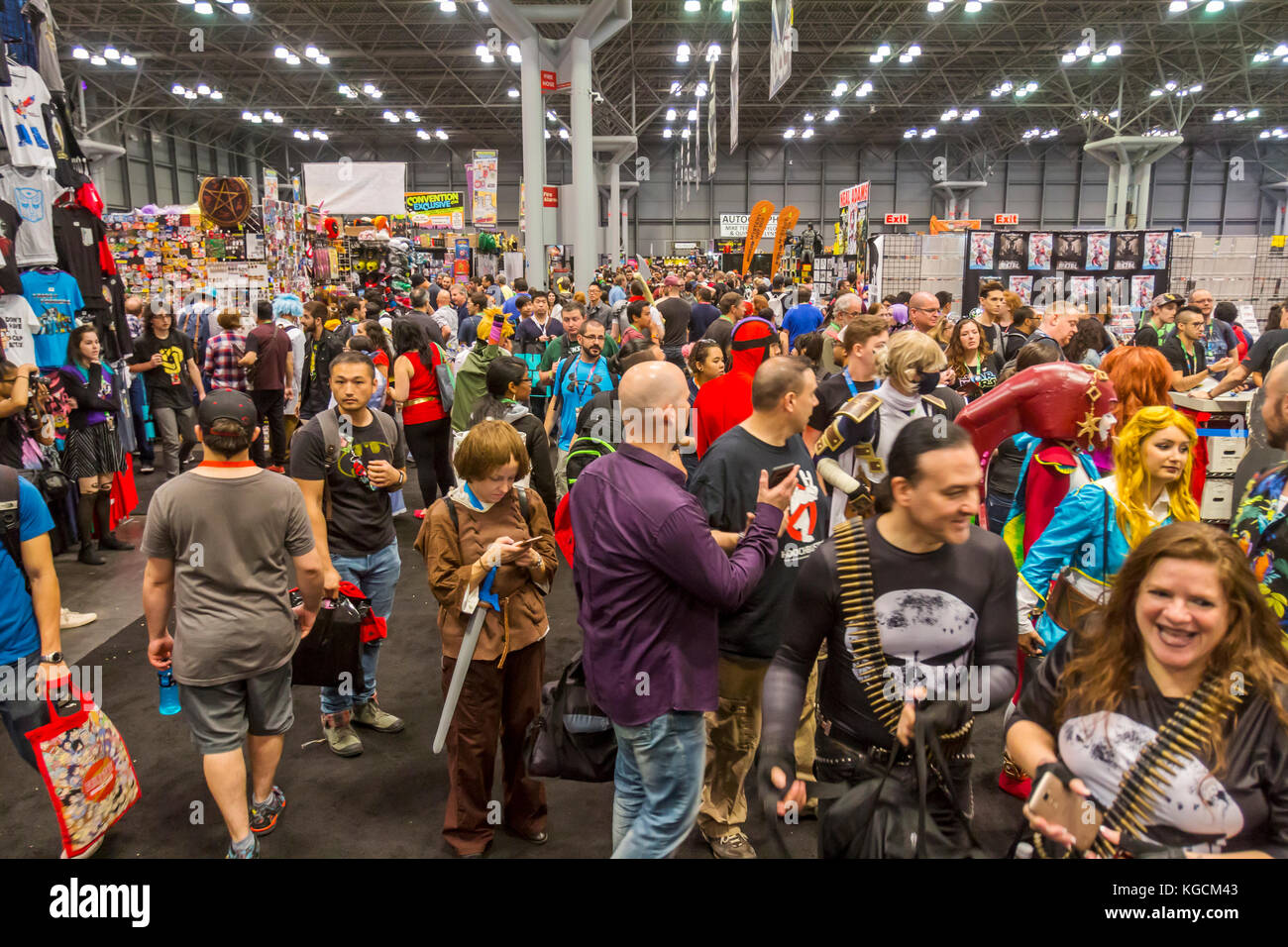 Visitors and fans attend the New York Comic Con Comic Book, Movie and Convention. - Stock Image