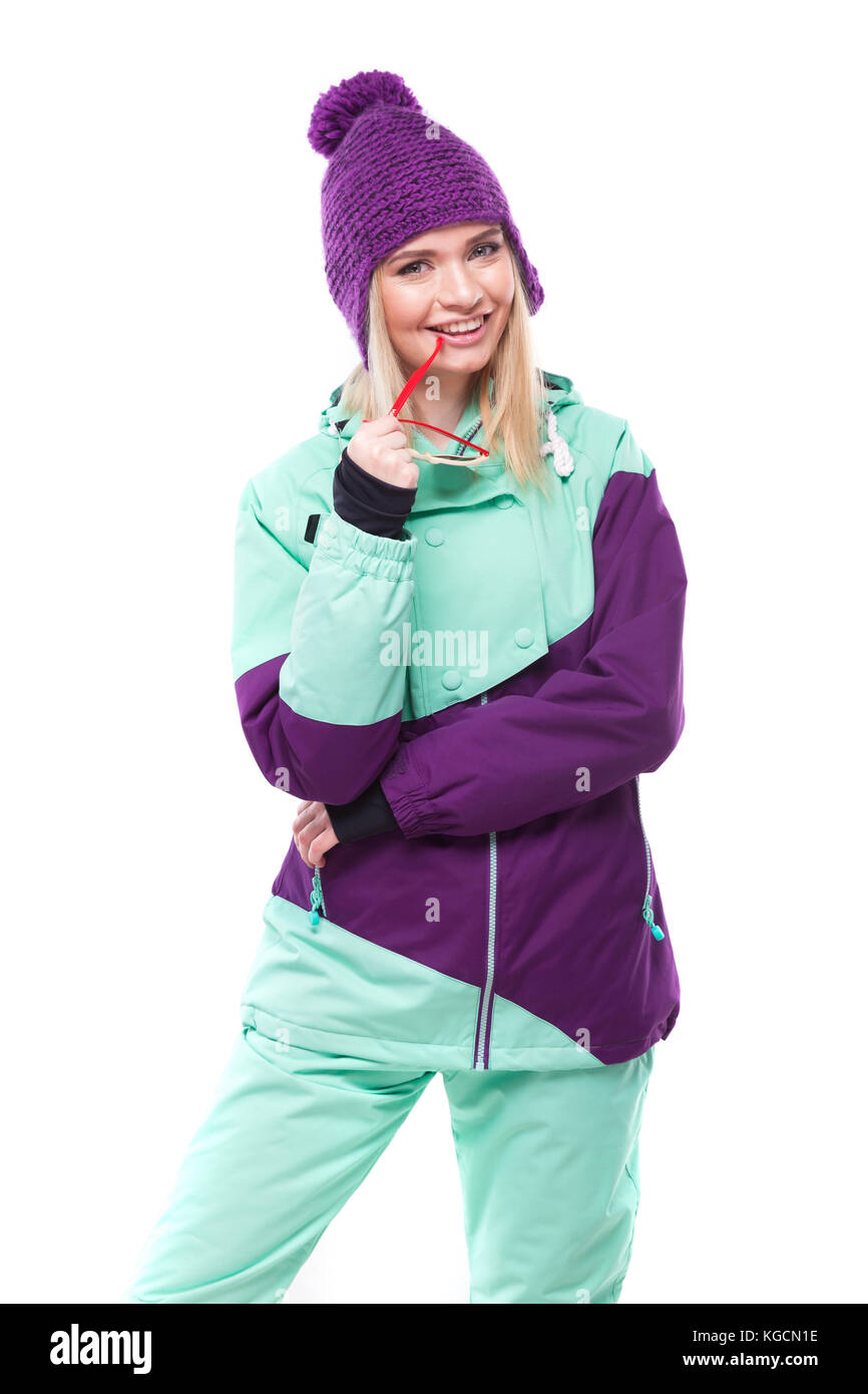 young attractive woman in purple ski suit - Stock Image