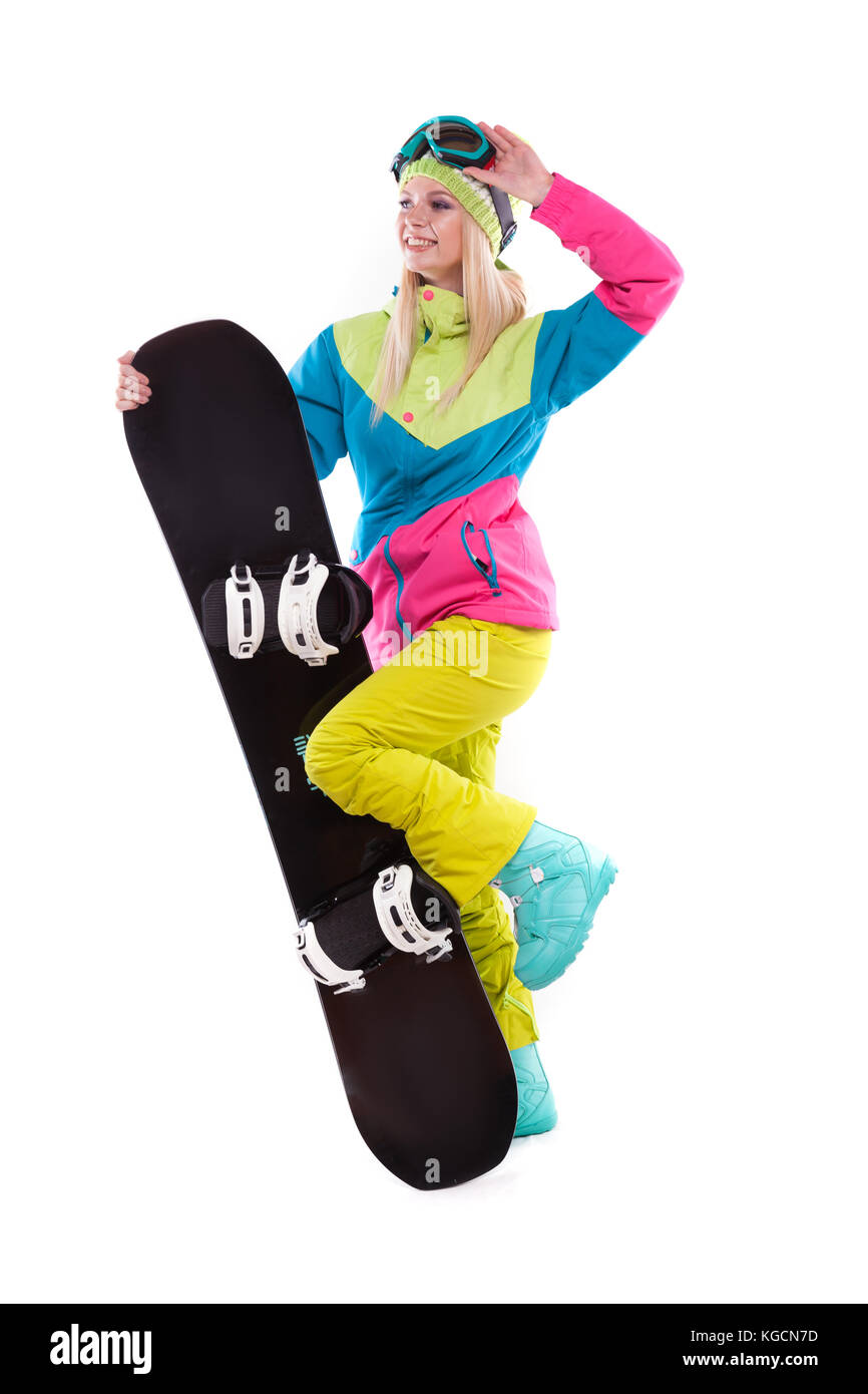 beauty young woman in ski suit and ski glasses hold snowboard - Stock Image