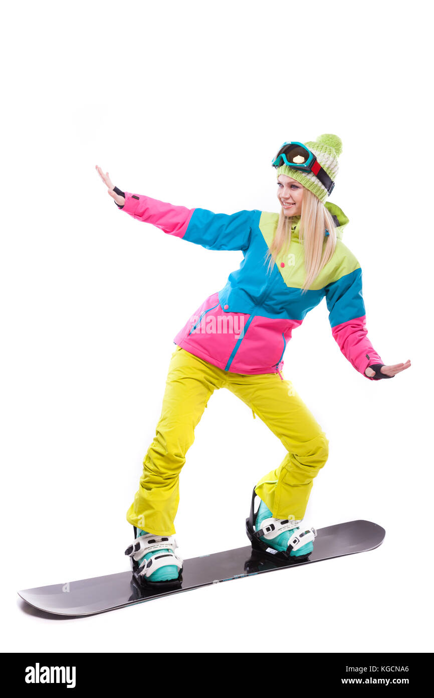 beauty young woman in ski suit and ski glasses ride snowboard - Stock Image