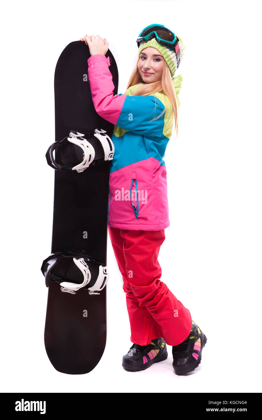 pretty young woman in ski outfit and ski glasses hold snowboard - Stock Image