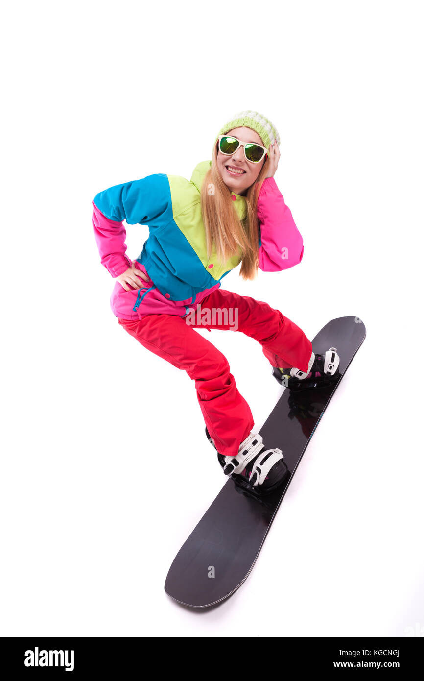 pretty young woman in ski outfit and sunglasses ride snowboard - Stock Image