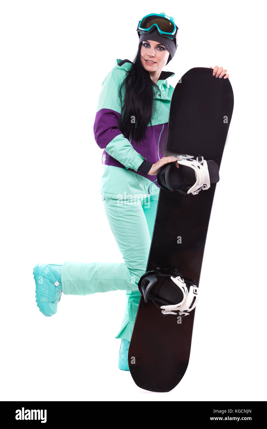 young pretty woman in purple ski suit hold snowboard - Stock Image