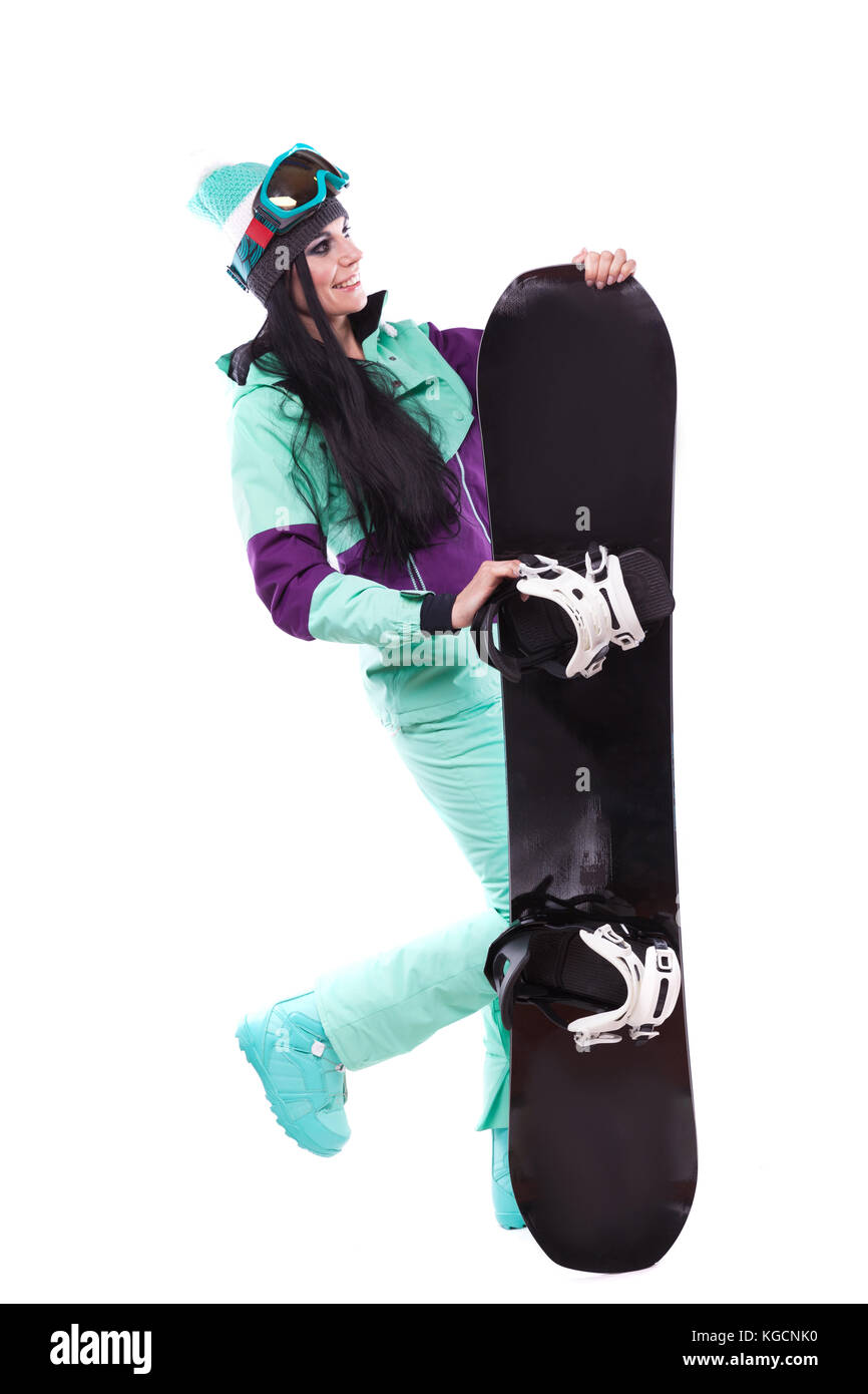 young pretty woman in purple ski costume hold snowboard - Stock Image