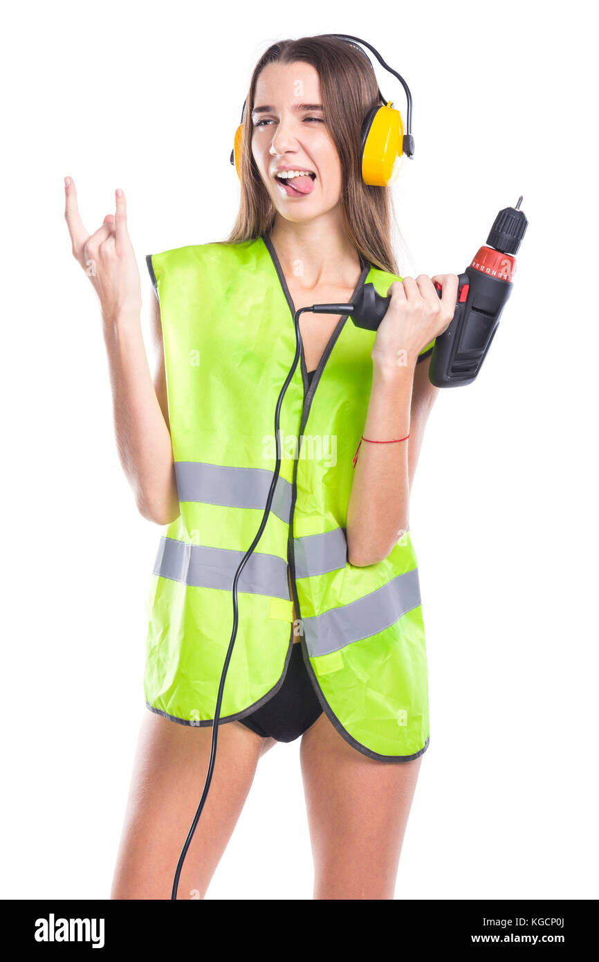 studio portrait of a girl in a bathing suit and a yellow construction vest - Stock Image