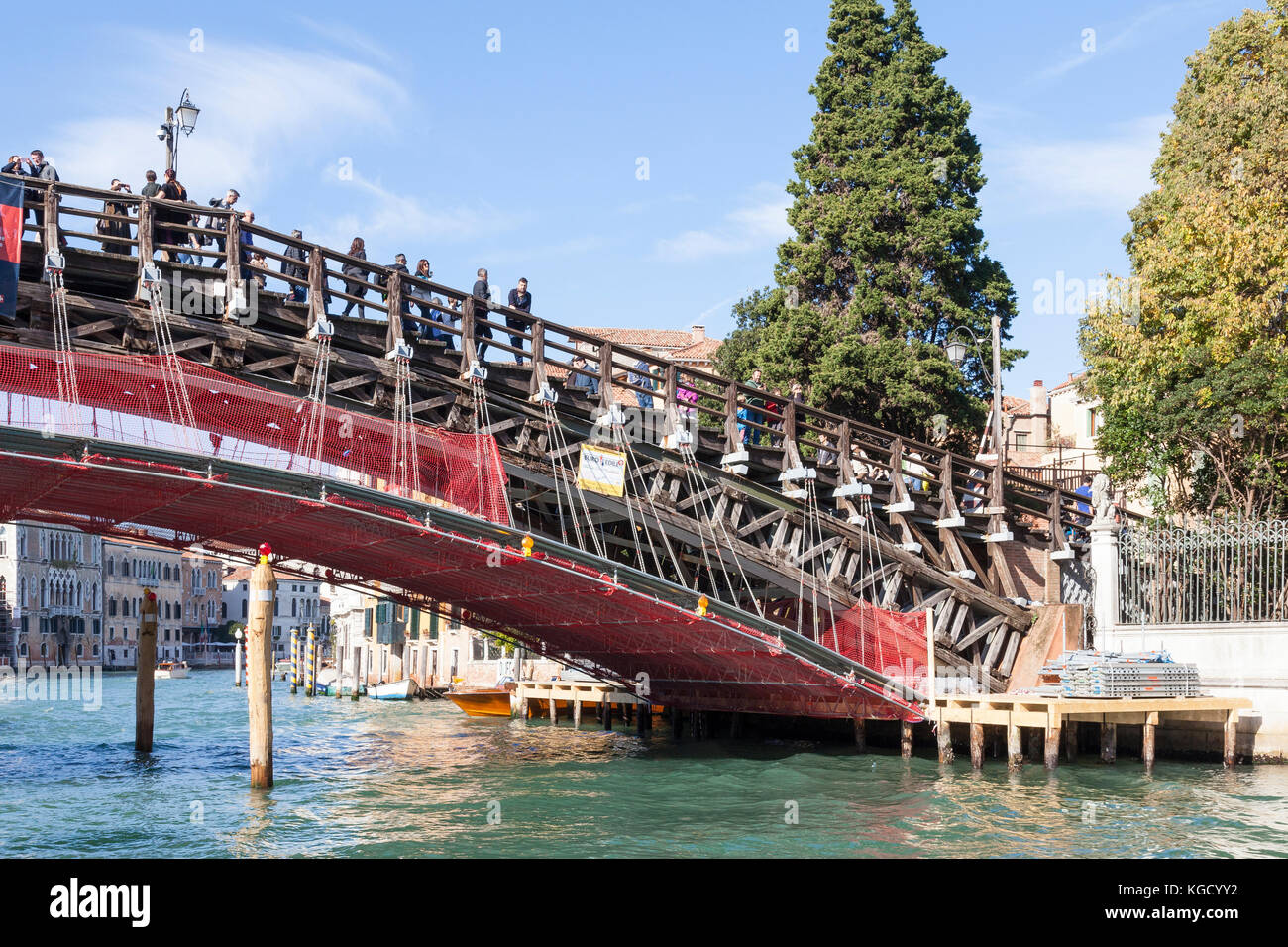 Restoration work being done on the Accademia Bridge, Grand Canal, Venice , Italy funded by Luxottica eye glasses - Stock Image