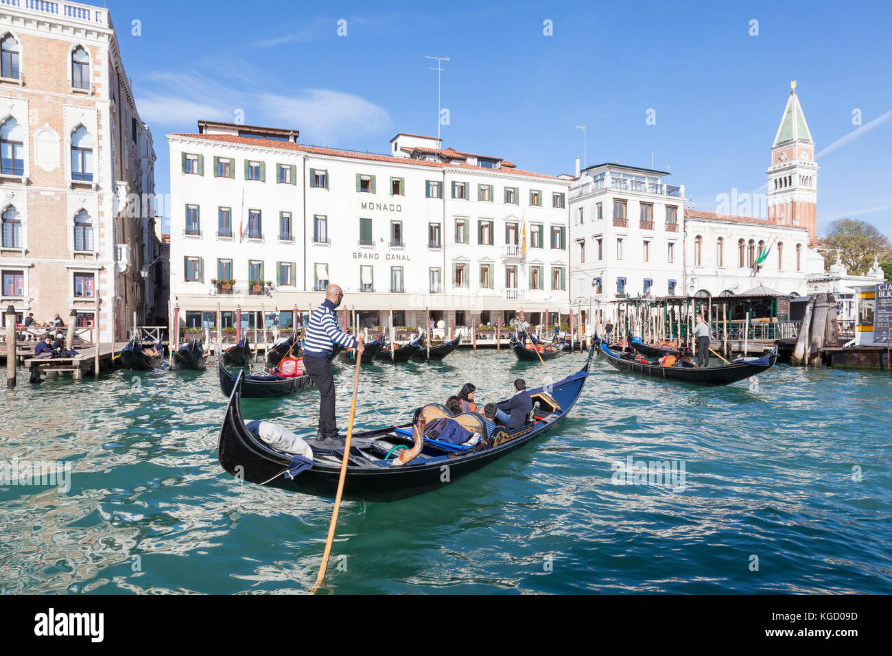 Gondolas with tourists on the Grand Canal, Venice, Italy queuing up to offload their customers at San Marco. Close - Stock Image