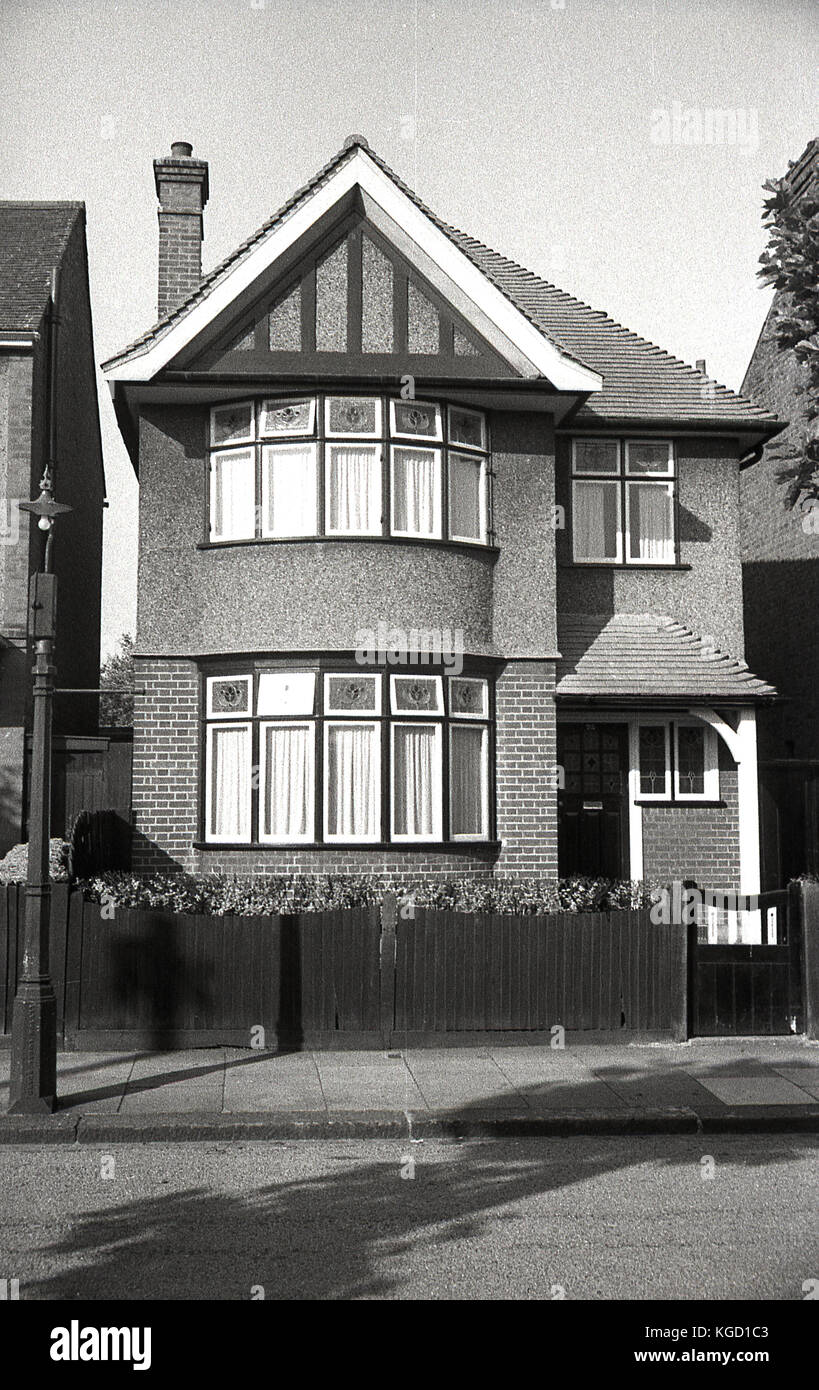 1940s, England, exterior view of a well-built detached house in the suburbs. Built in a traditional style in the Stock Photo