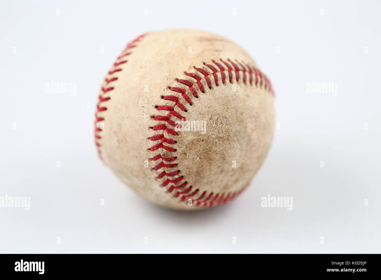 Isolated image of used baseball in white background - Stock Image