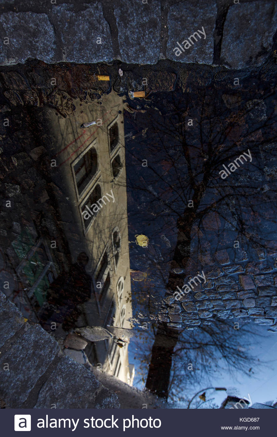 Reflection of a Street Walker - Stock Image