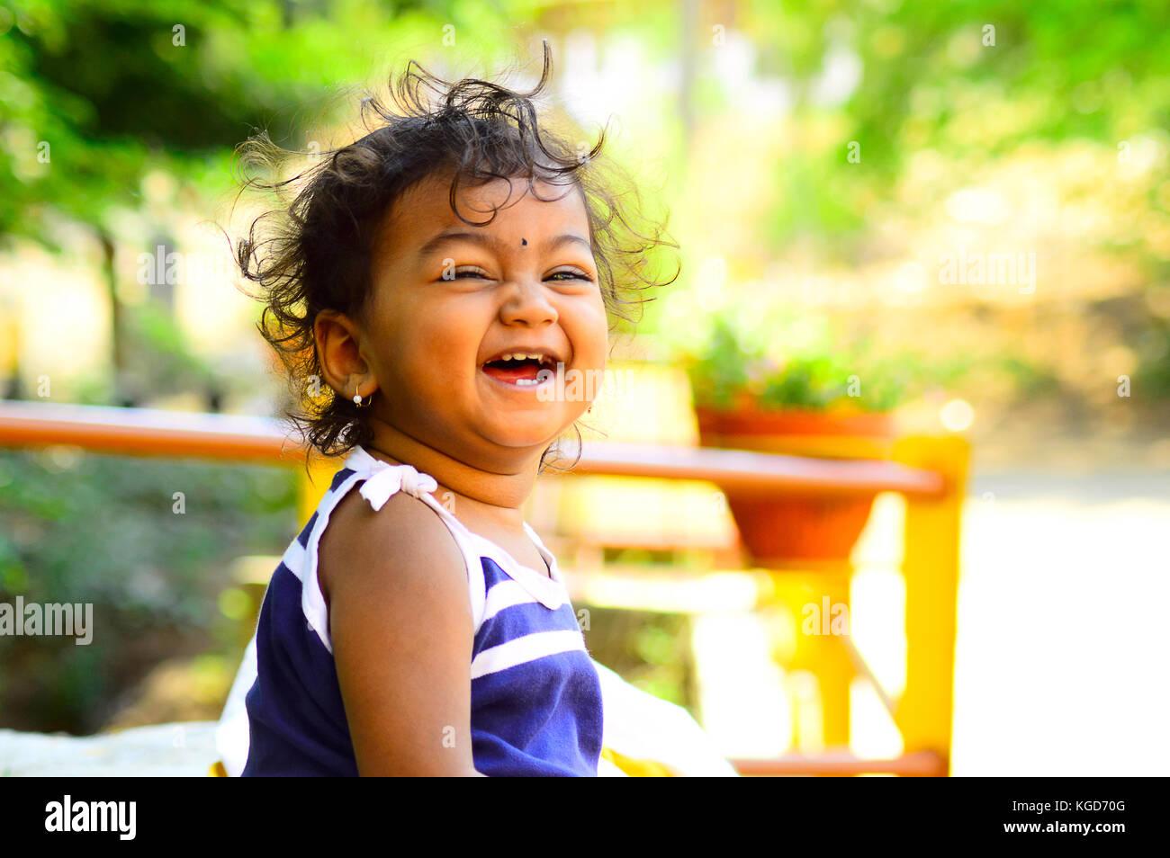 Cute baby laughing facing camera Stock Photo