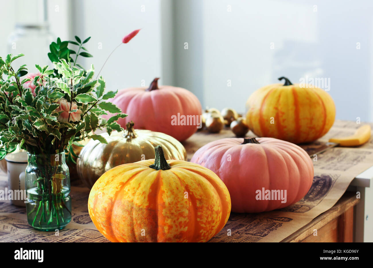 Painted pumpkins in the creative workshop - Stock Image