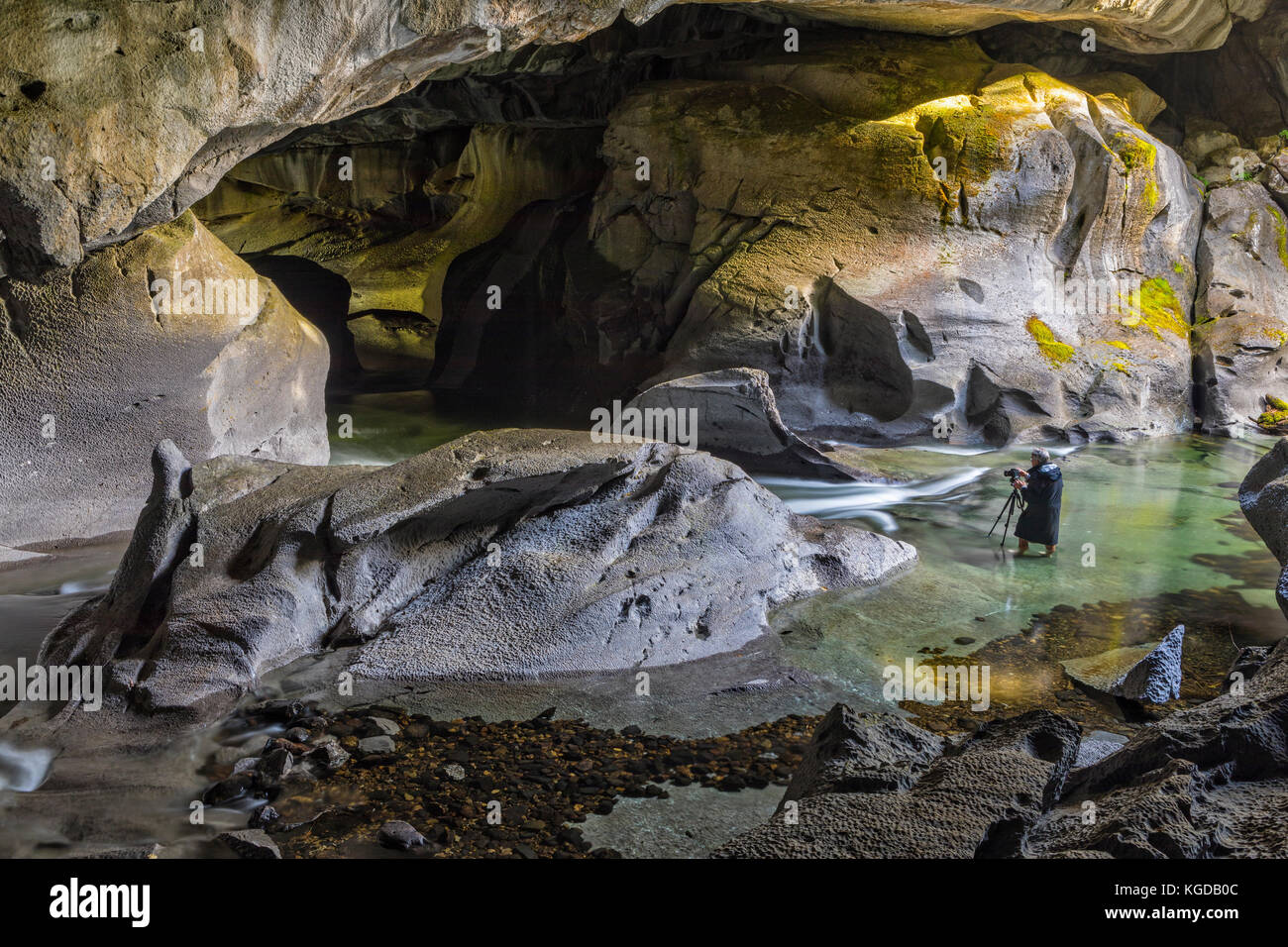 Bob photographing during a photography workshop with Rolf Hicker in little Huson Cave Regional Park, Northern Vancouver - Stock Image