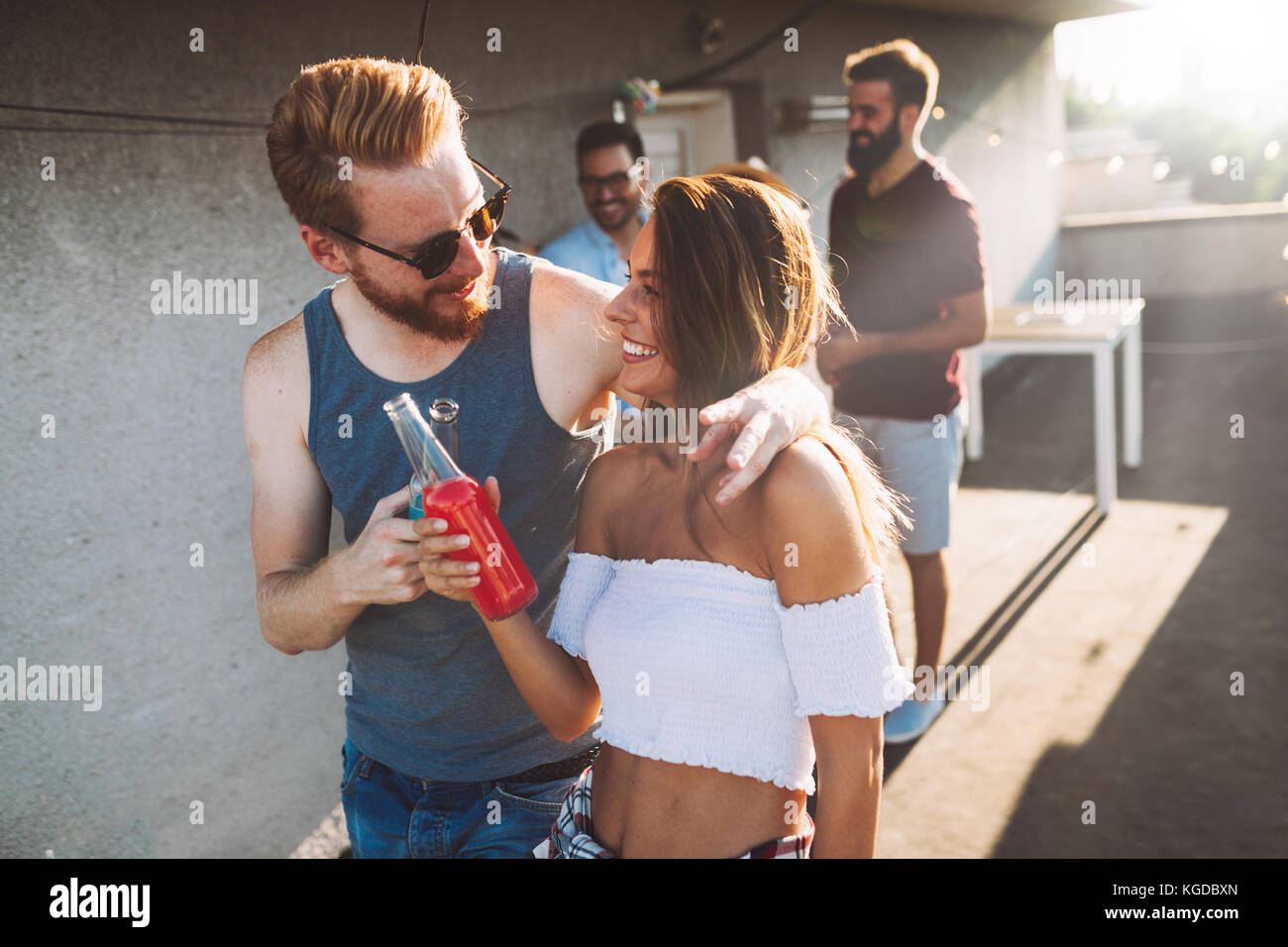 Happy couple having fun time at party - Stock Image