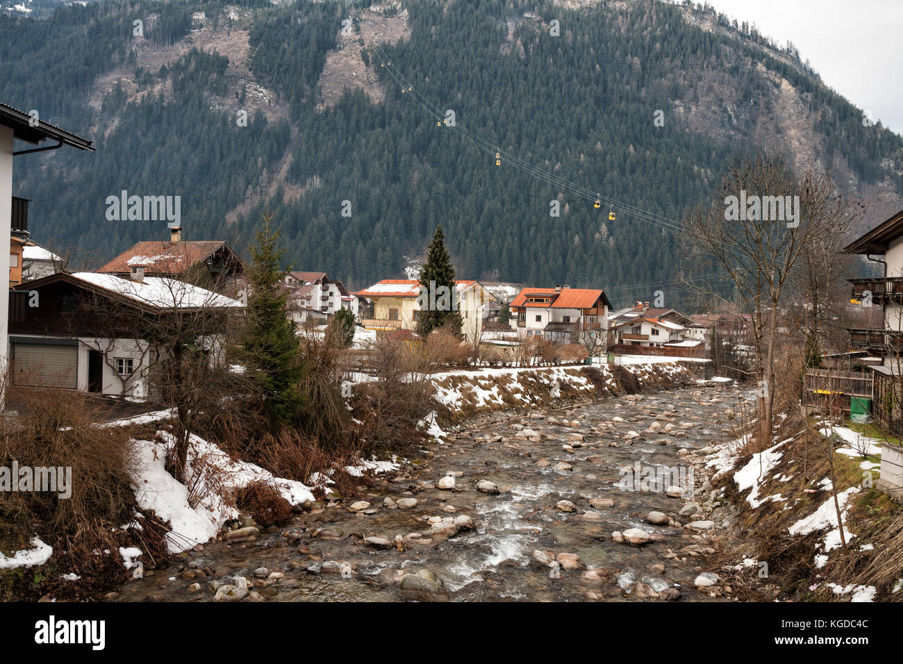 Winter Mayrhofen and cable car above the city - Stock Image