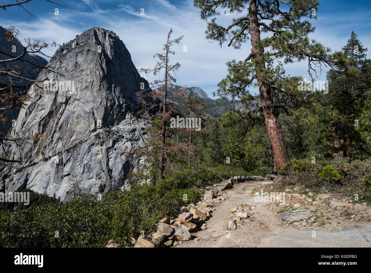 A side view of half dome from a hiking trail in Yosemite National Park. - Stock Image