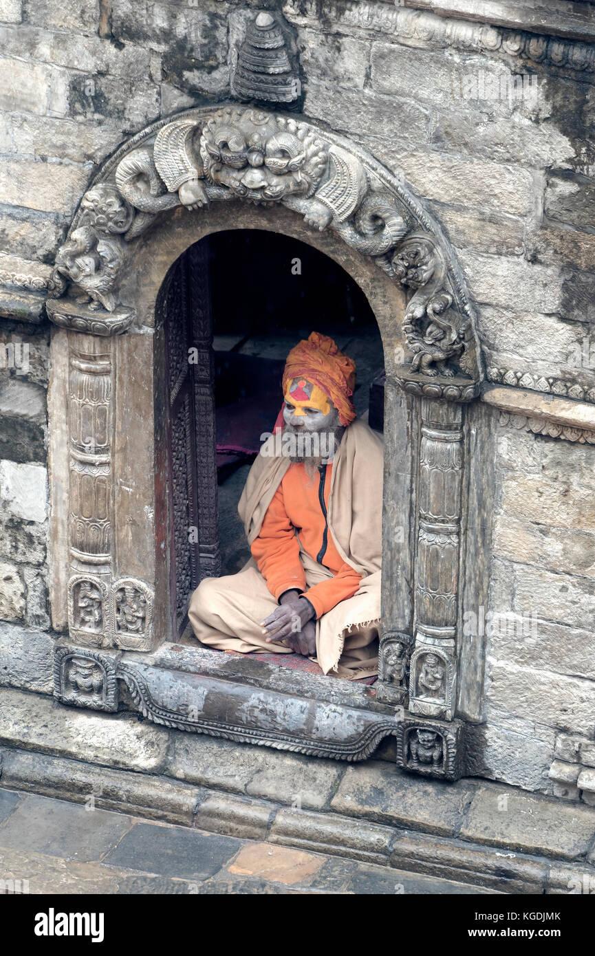 Hinduist Sadhu seated in a shrine, Holy Man, Pashupatinath Temple, Kathmandu, Nepal - Stock Image