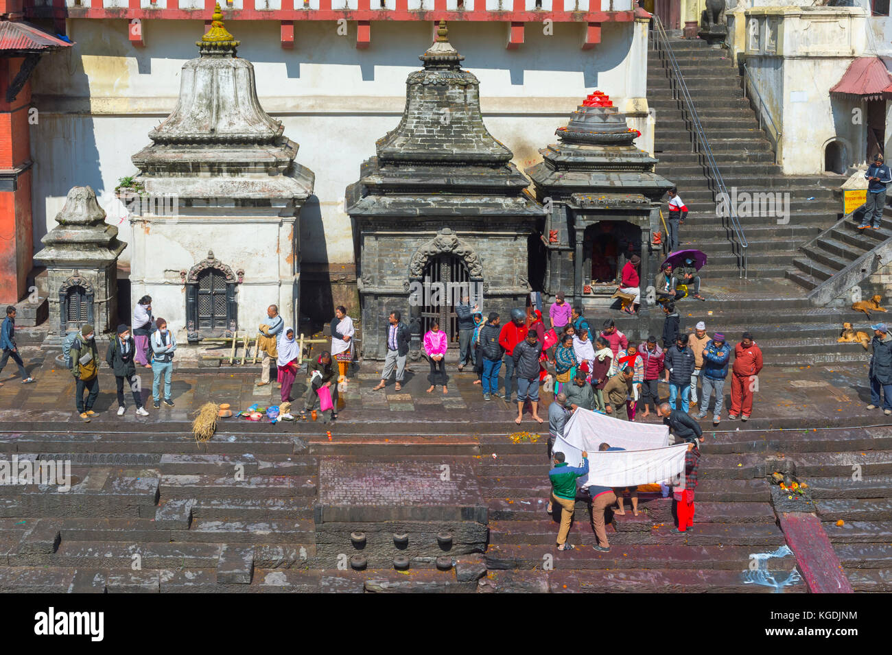 Cremation ghat along the Bagmati river, Pashupatinath Temple complex, Unesco World Heritage Site, Kathmandu, Nepal - Stock Image