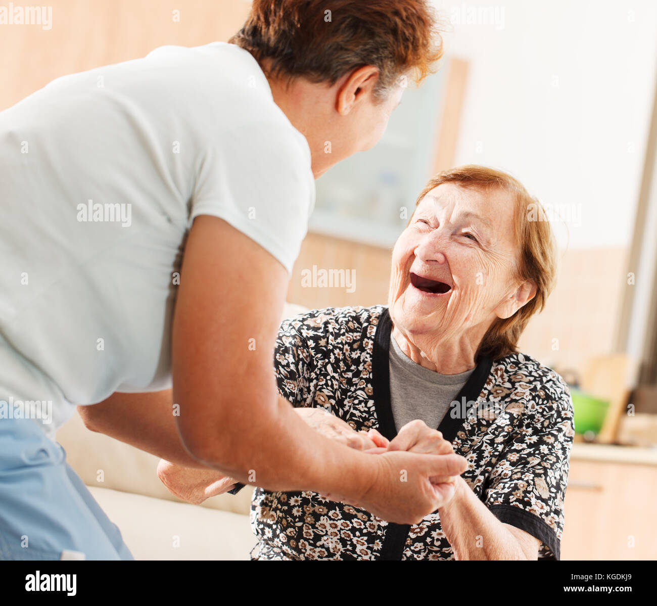 Mother and daughter holding each other - Stock Image