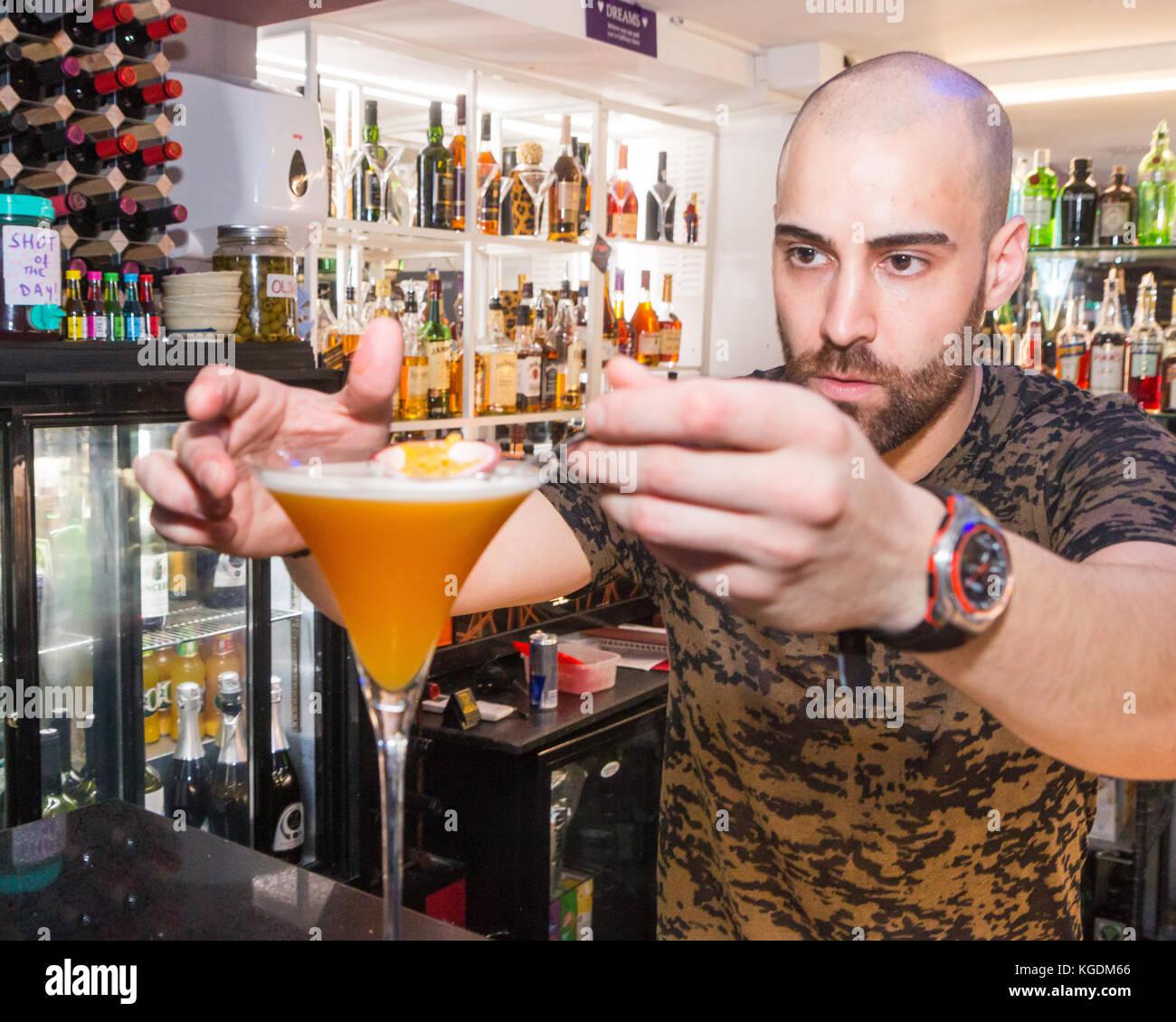 Barman preparing a cocktail - Stock Image