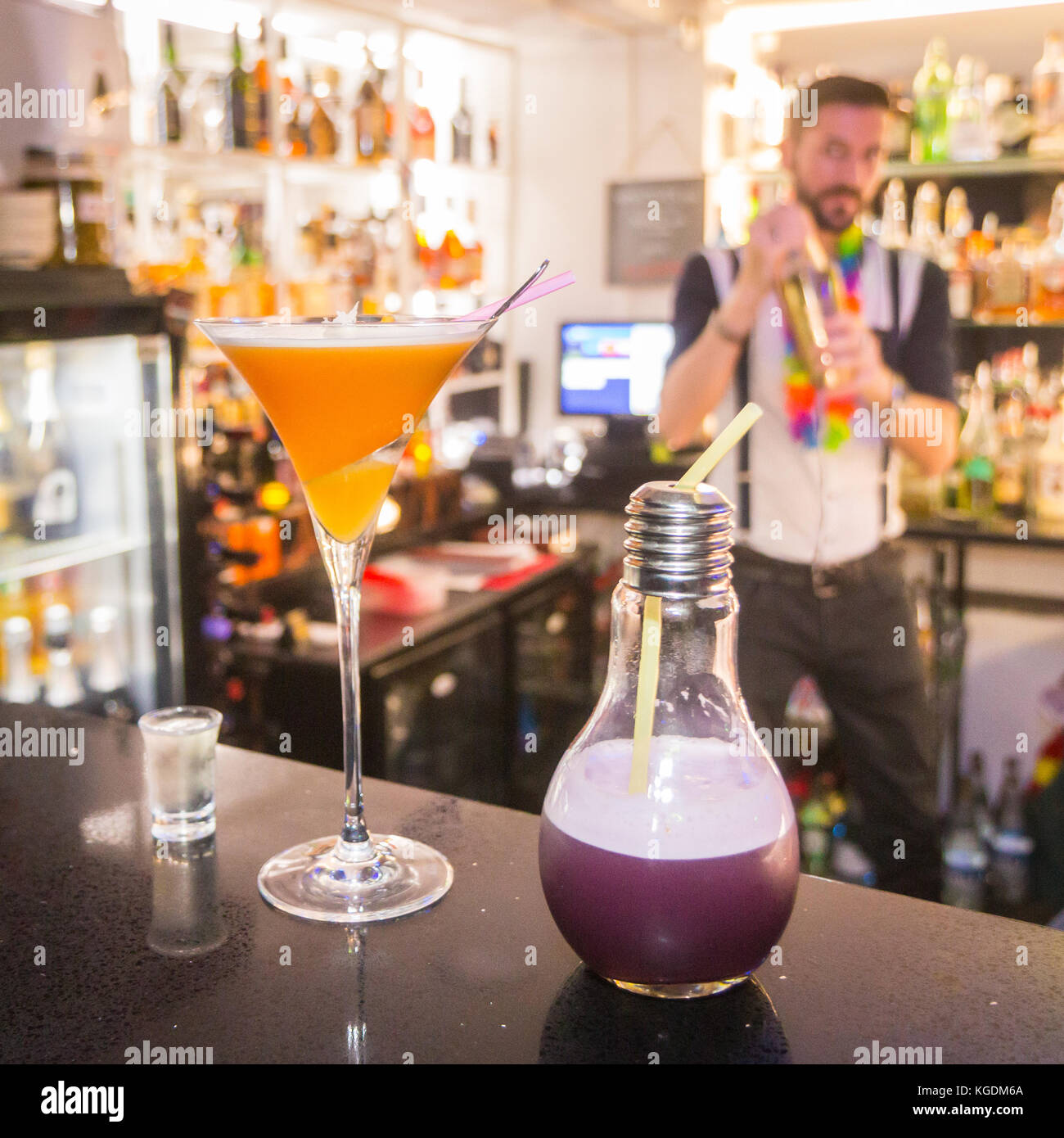 close up of cocktail with barman in the background - Stock Image