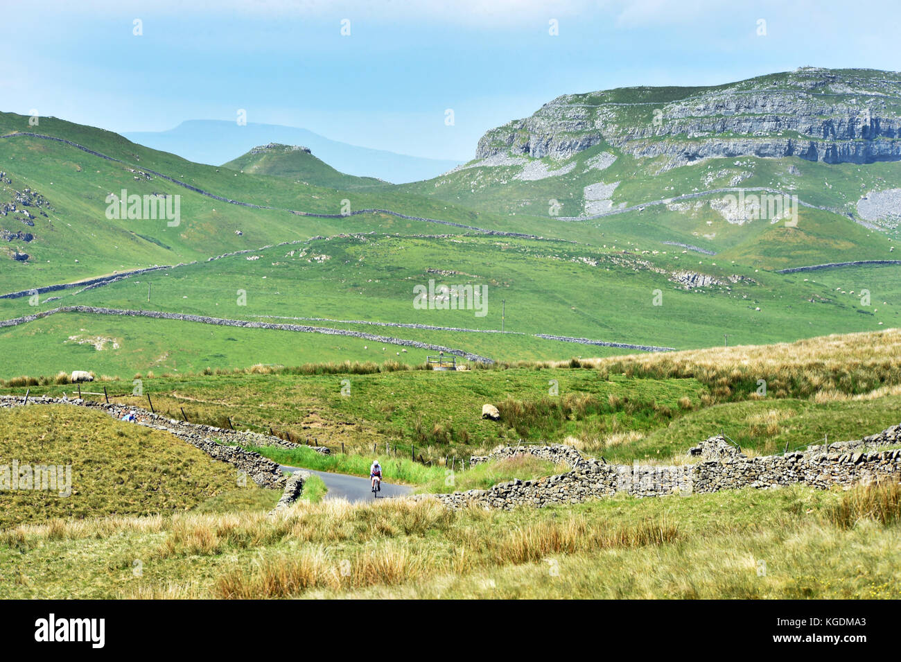 A cyclist cycling in the beautiful Yorkshire Dales Attermire Scar near Settle - Stock Image