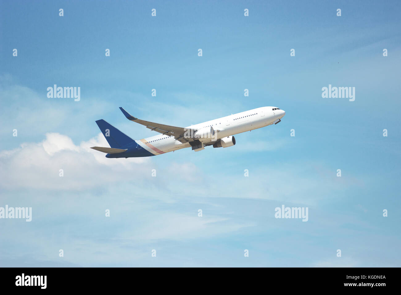 Plane flying through clouds in the sky. Jet aircraft. Travelling concept. Aviation and aerospace industries concepts. - Stock Image