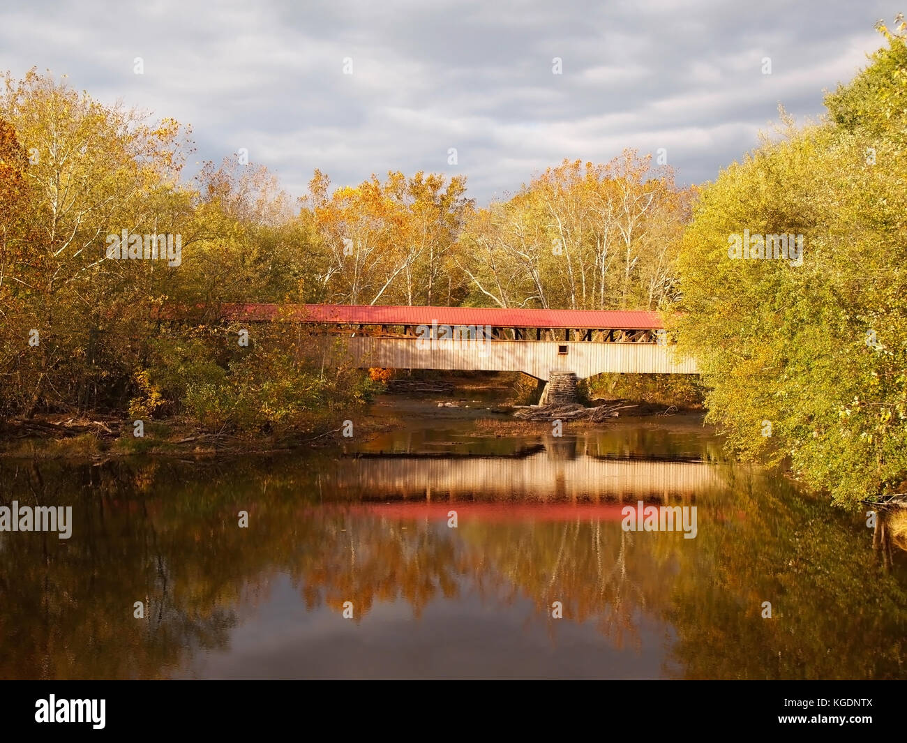 The Academia Pomeroy Covered Bridge, across the Tuscarora River in Juniata County, Pennsylvania, on an autumn day. Stock Photo