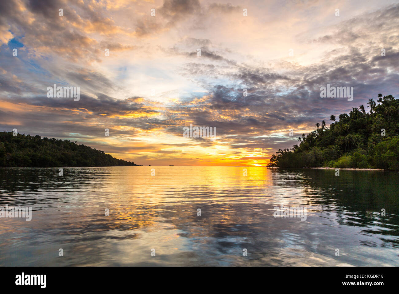 Stunning sunset in the Togian (or Togean) islands in Sulawesi, a remote corner of Indonesia still untouched by pollution - Stock Image