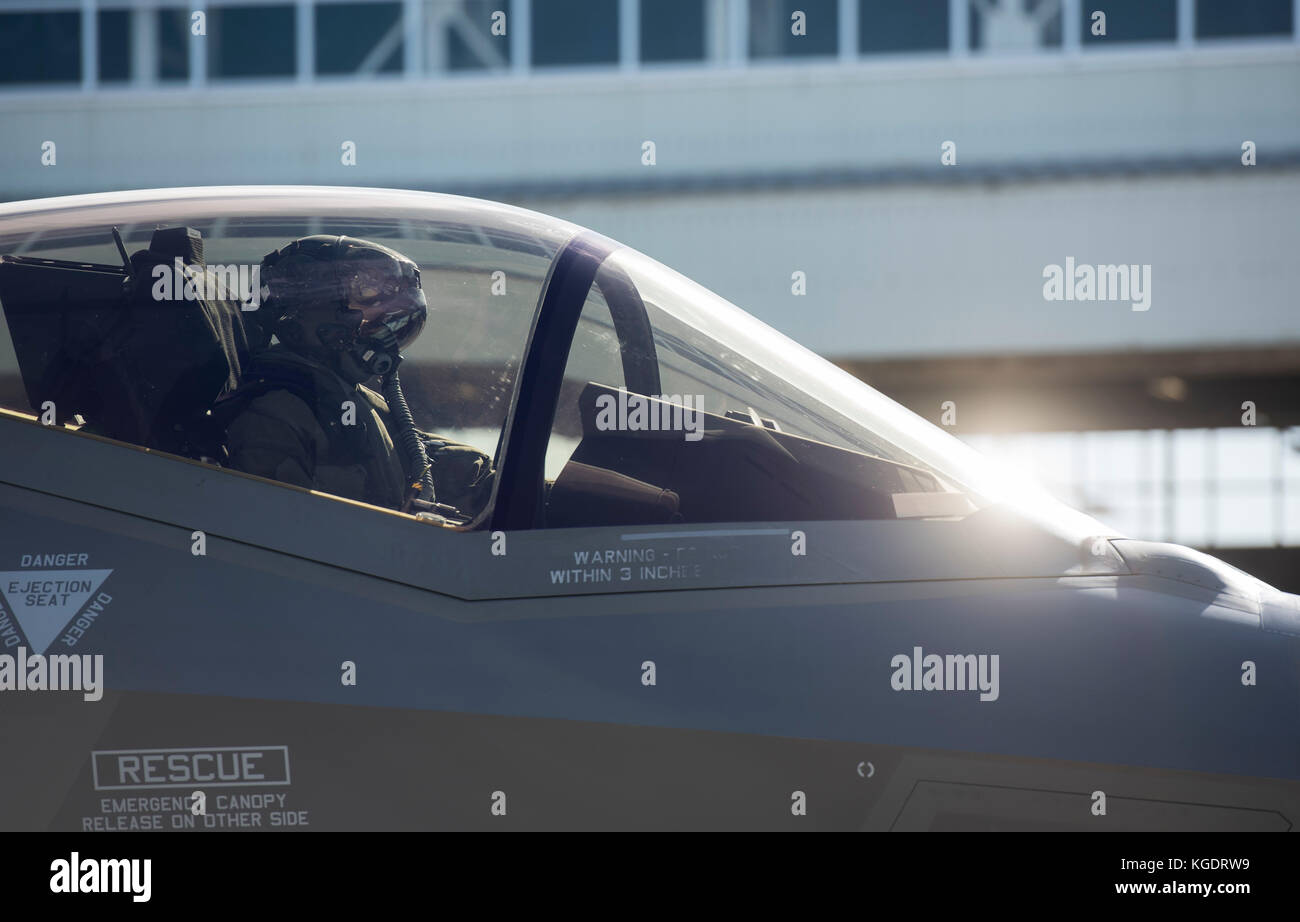 A U.S. Air Force F-35A Lightning II pilot from Hill Air Force Base, Utah, taxis for take-off at Kadena Air Base, - Stock Image