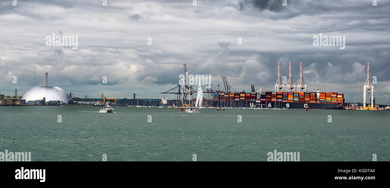 Port of Southampton with Marchwood ERF incinerator & container vessel, Southampton Water, England, UK. - Stock Image