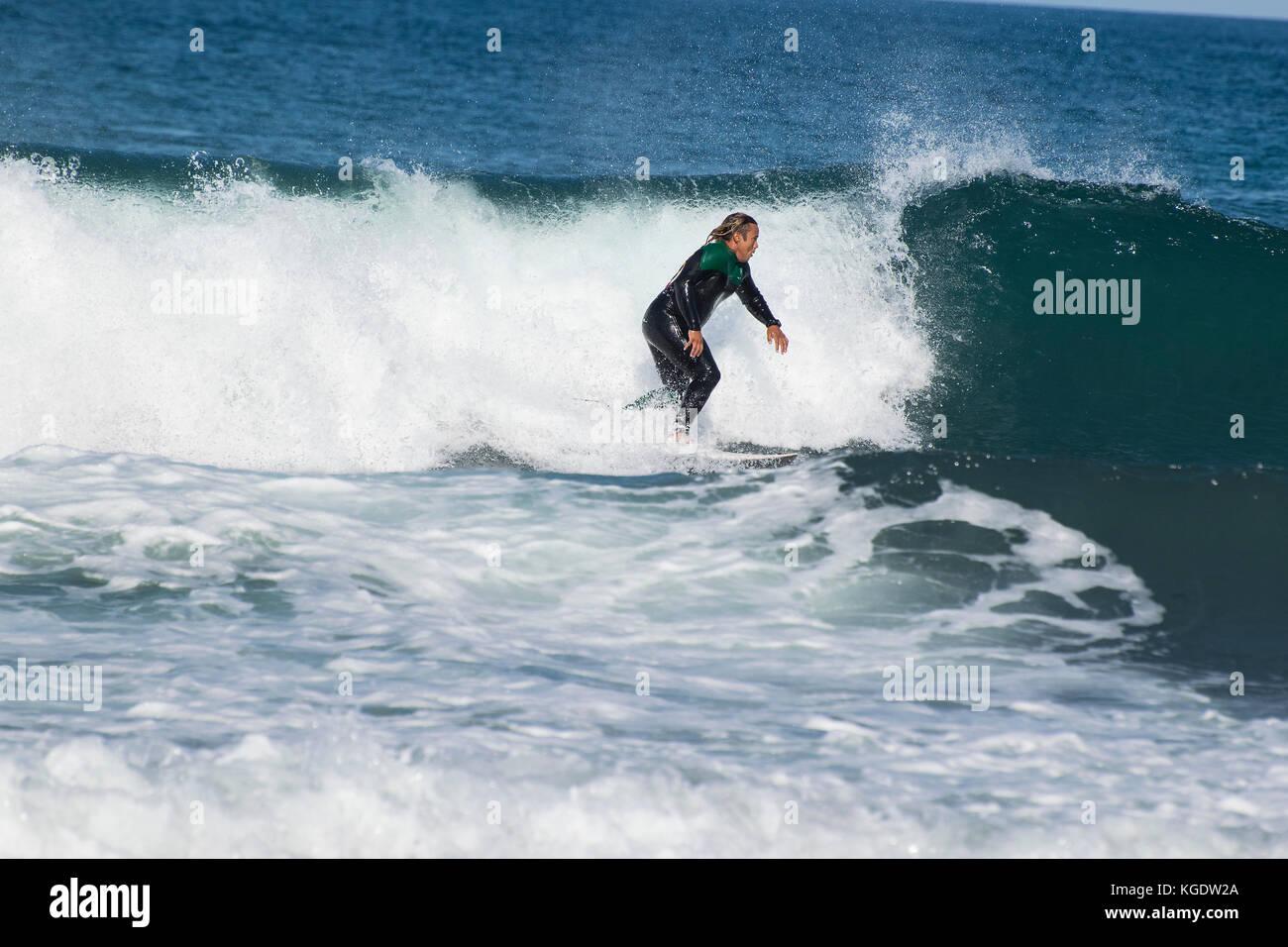 Surfer having fun in Son de Marina, Mallorca, Spain - Stock Image