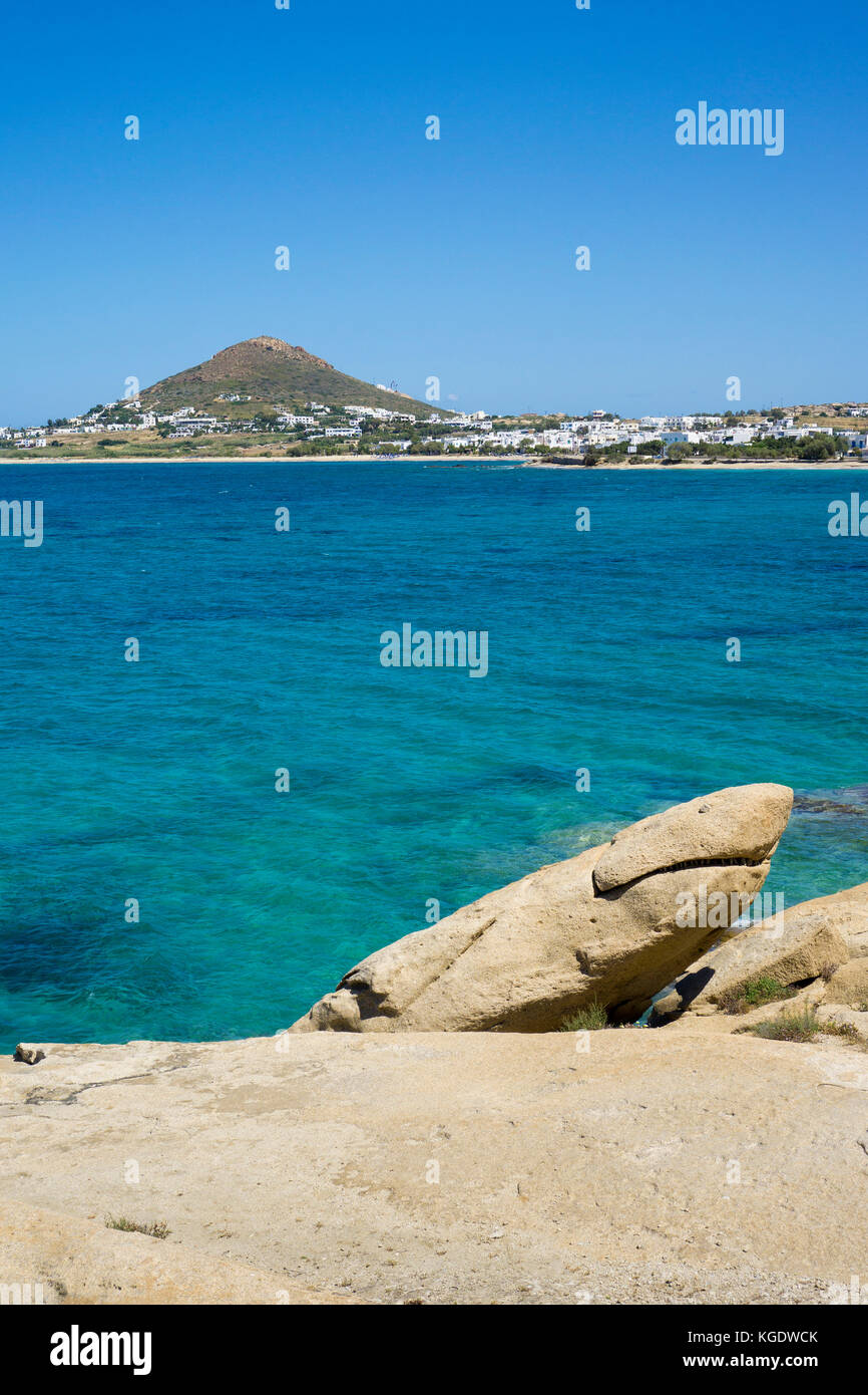 Rock shows shape of a shark, beach of Agia Anna, west side of Naxos island, Cyclades, Aegean, Greece - Stock Image