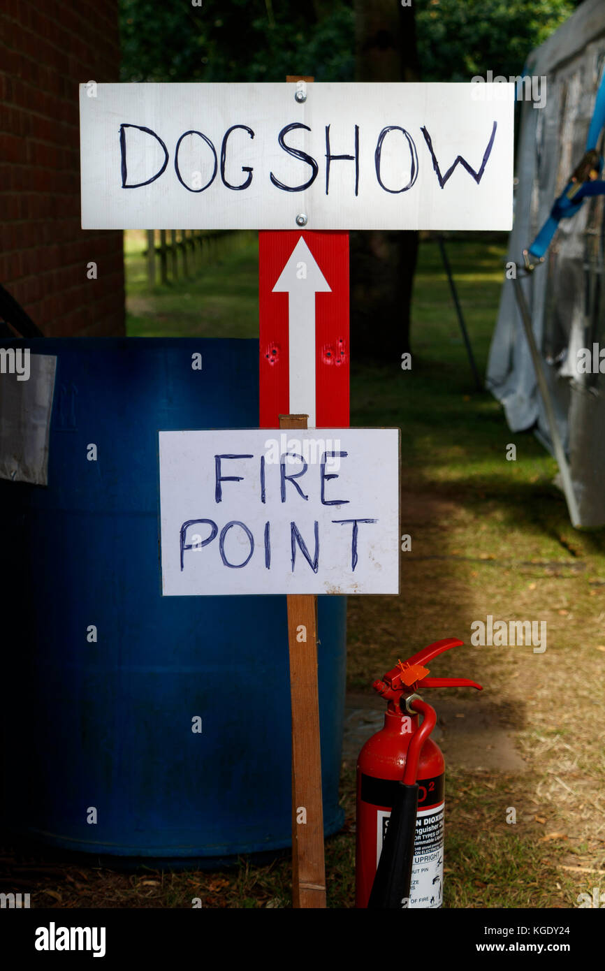 Humorous sign at a rural agricultural show indicating the fire point at the dog show. Norfolk, UK. - Stock Image