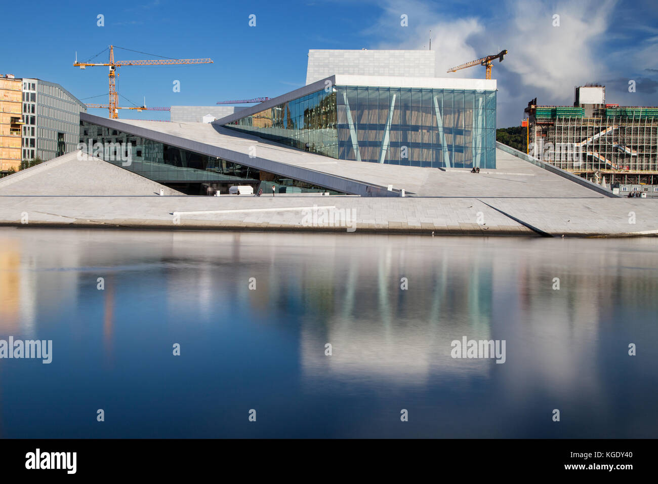 Opera House of Oslo, Norway. Situated in the Bjorvika neighborhood, at the head of the Oslofjord, it was designed - Stock Image