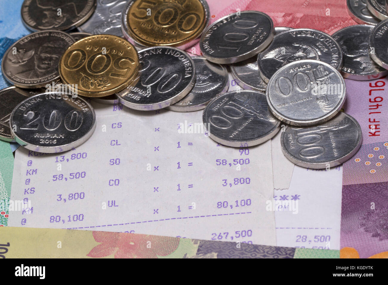 Spending Money and Payment Illustrated with coins, bank notes and receipt paper - Stock Image