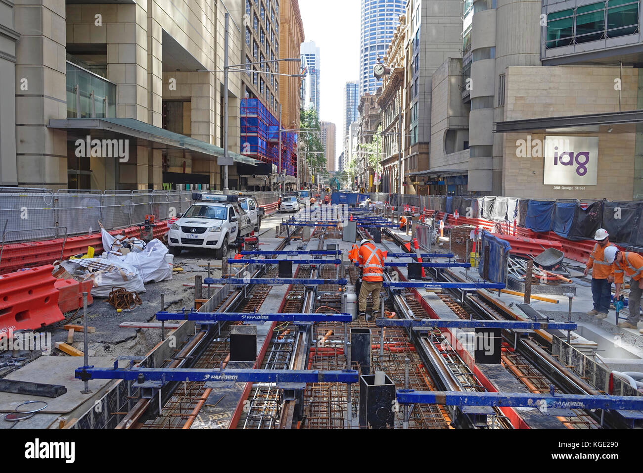 Construction work laying steel rail tracks along George Street in Sydney's CBD (central business district) for - Stock Image