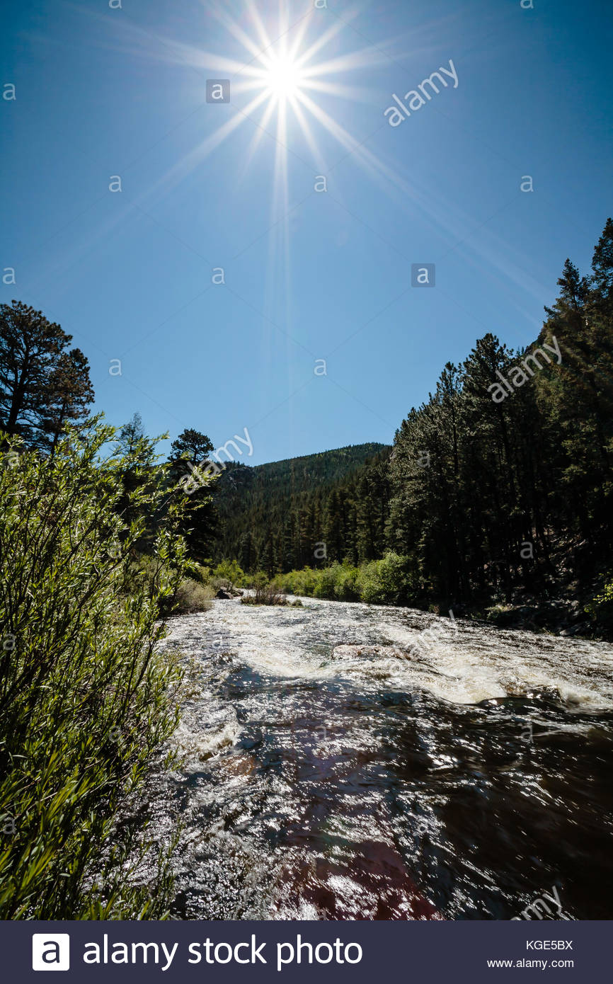 Big Thompson River, early morning sunstar, just outside Rocky Mountain National Park in Colorado - Stock Image