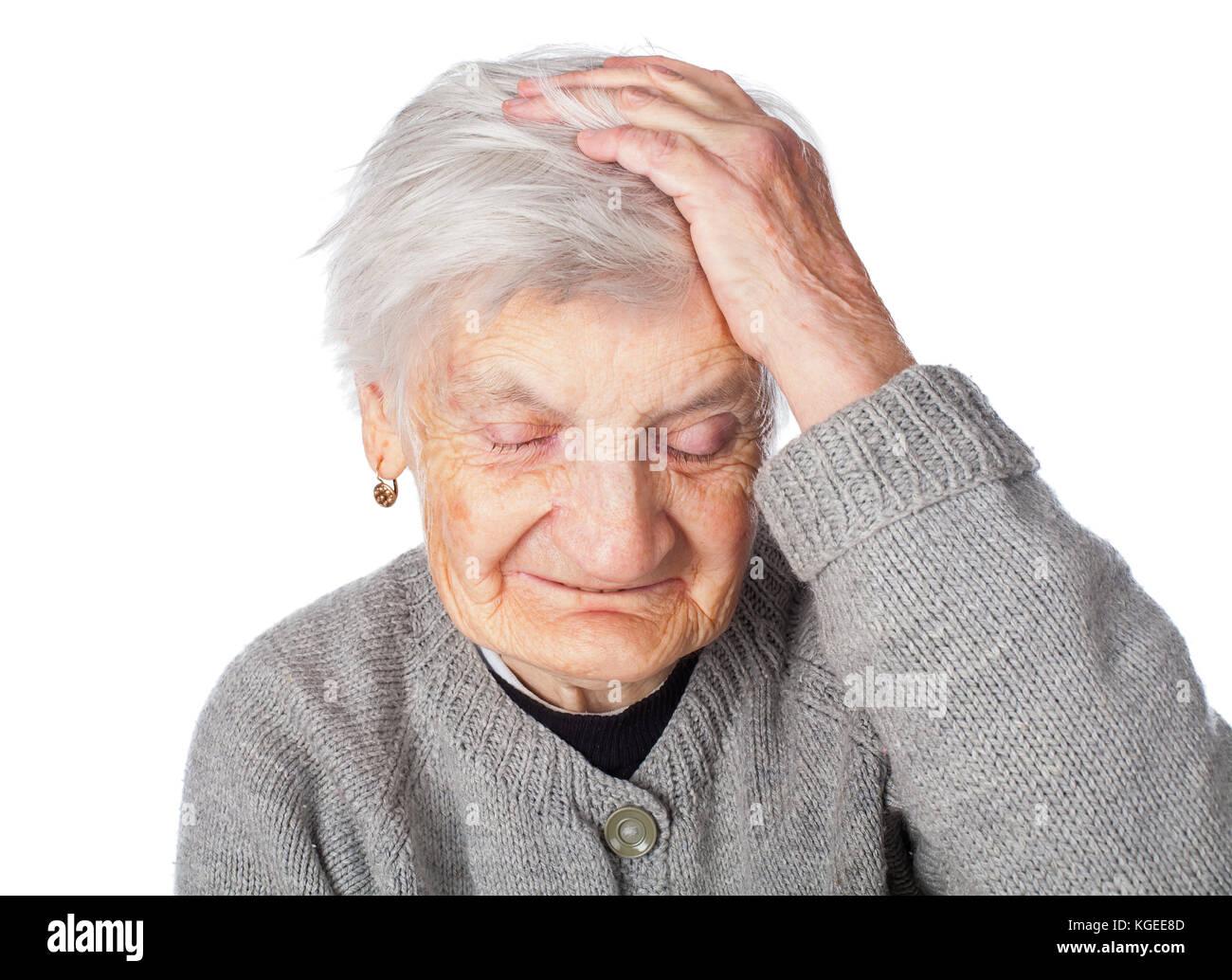 Portrait of a wrinkled senior woman posing for the camera - Stock Image