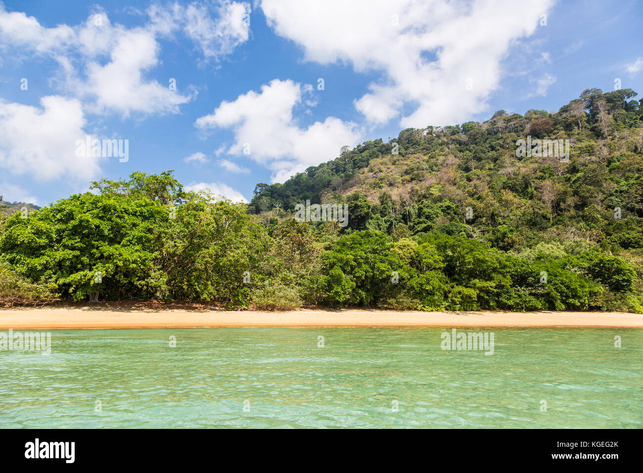 Idyllic empty beach in Tioman island in the South China Sea in Malaysia on a sunny day in Southeast Asia. - Stock Image