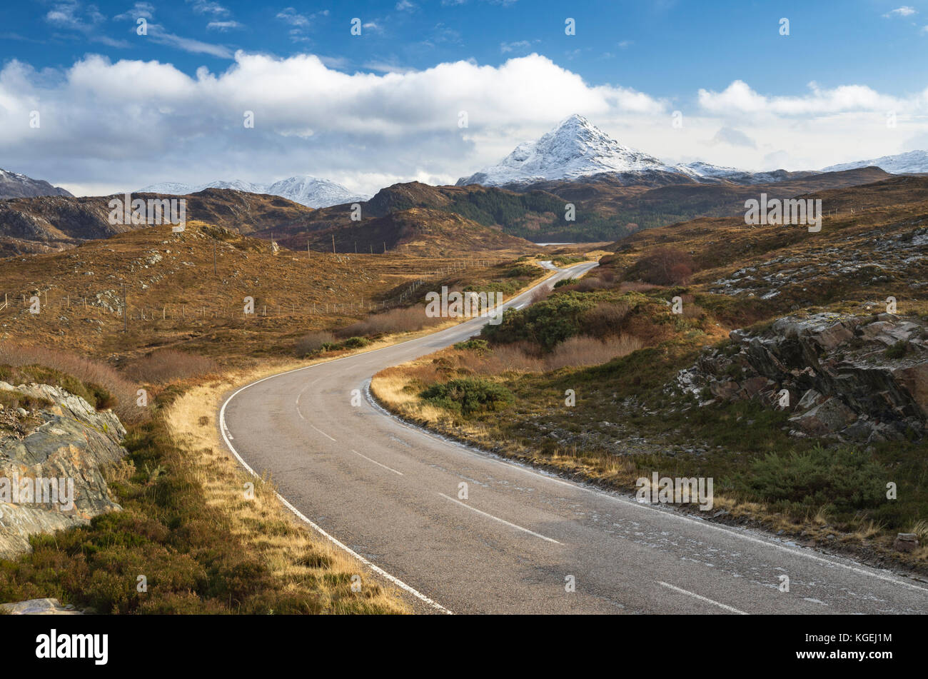 The A894 North Coast 500 route leading towards the snowy mountain of Ben Stack, Sutherland, Scottish Highlands, - Stock Image