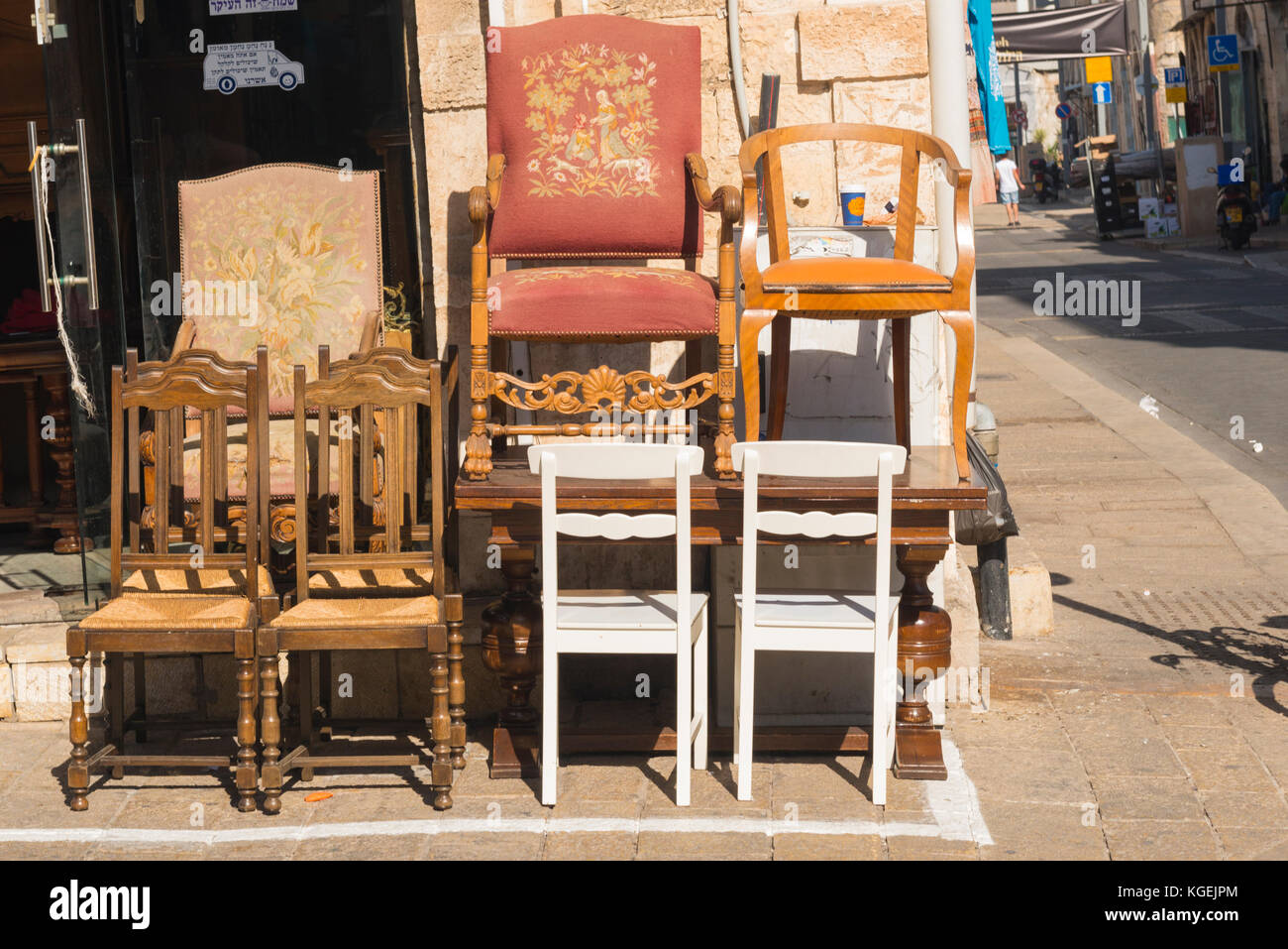 Israel The Holy Land Tel Aviv Jaffa Yafo old market souk collectables wood wooden furniture used secondhand tables - Stock Image