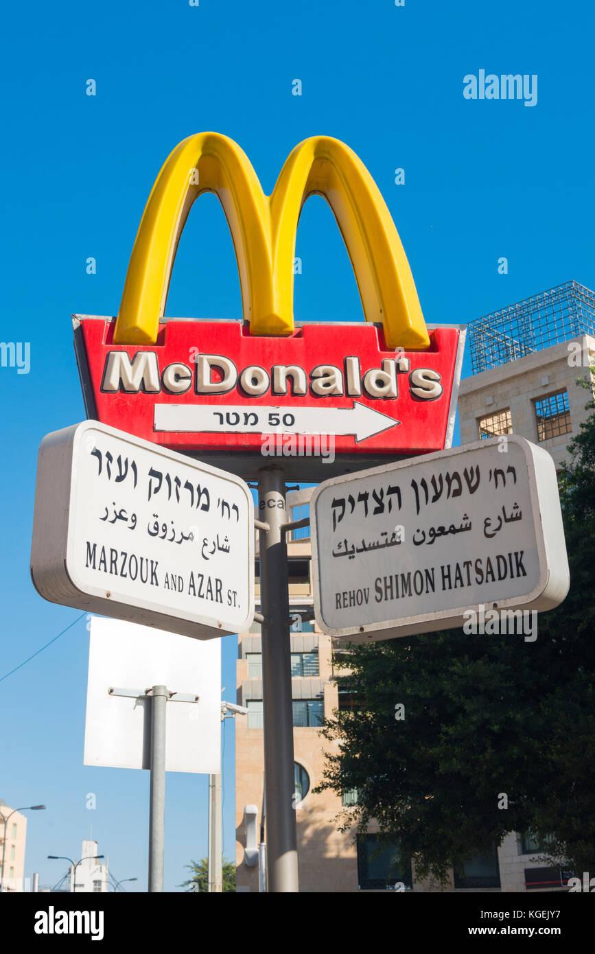 Israel The Holy Land Tel Aviv Jaffa Yafo road street sign signs Arabic Hebrew Ivrit English scene McDonald's - Stock Image
