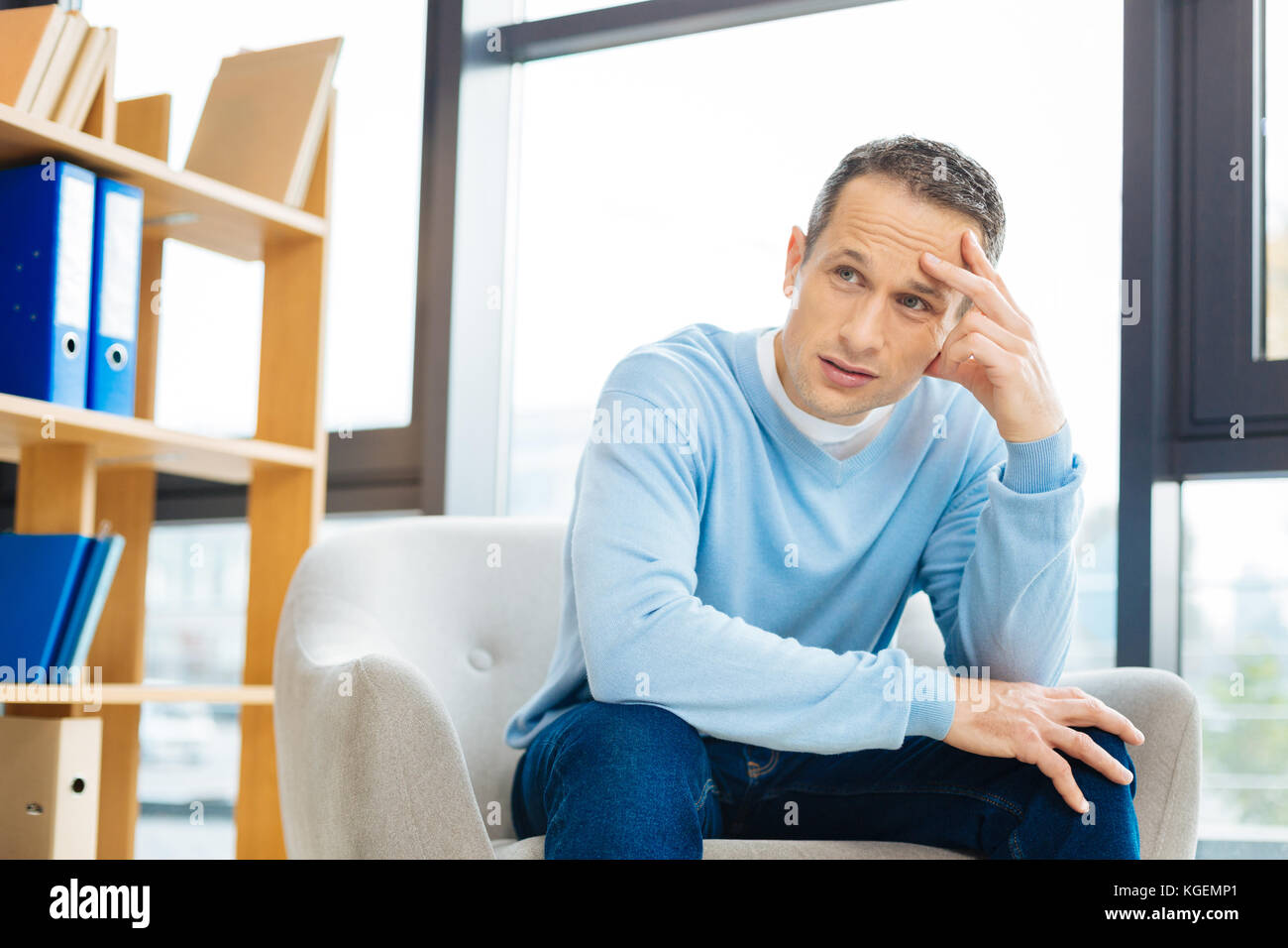 Cheerless adult man thinking about his life - Stock Image