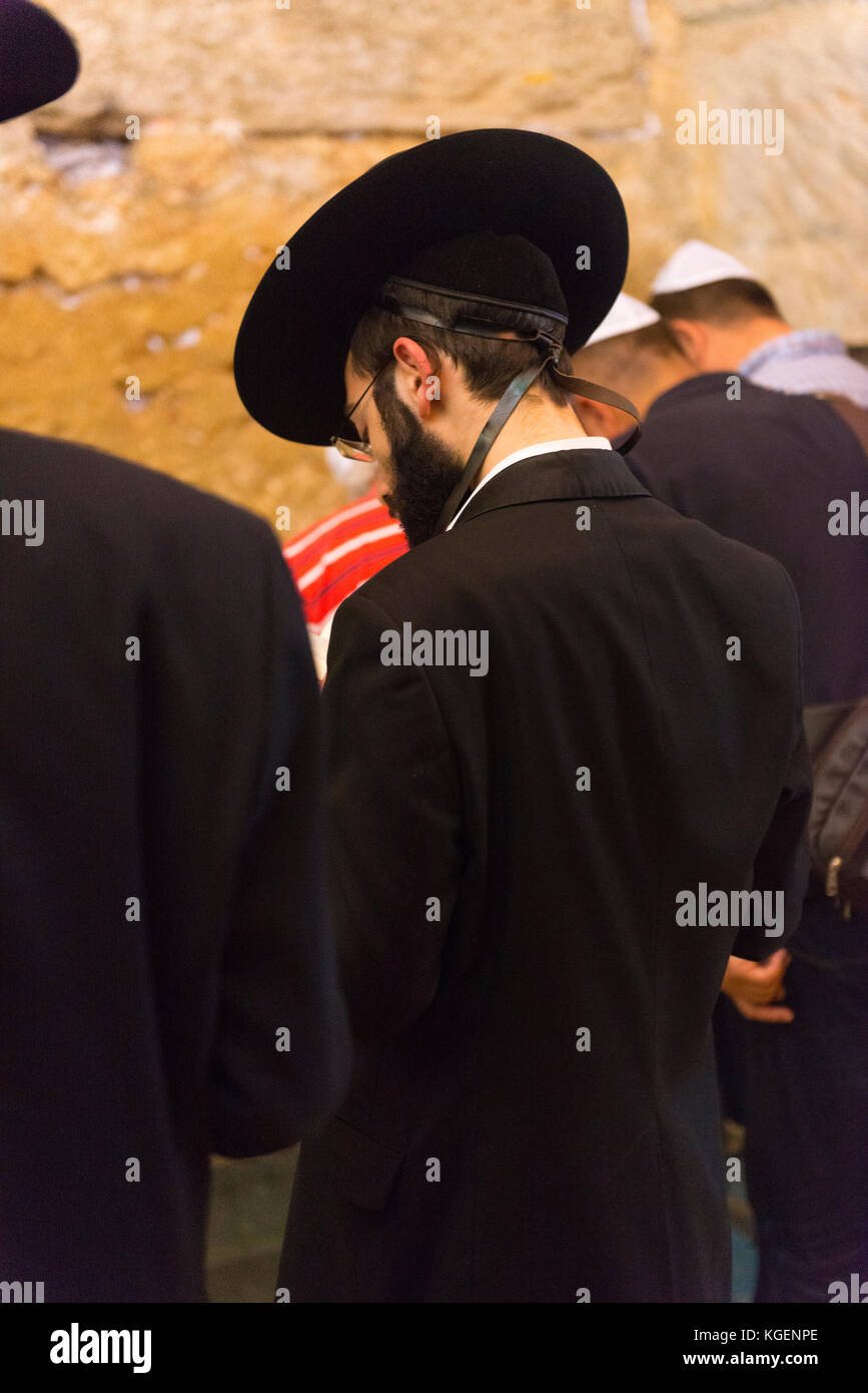 Israel The Holy Land Jerusalem Old City bearded young religious Hassidic Jew Jewish man black suit hat phylacteries - Stock Image