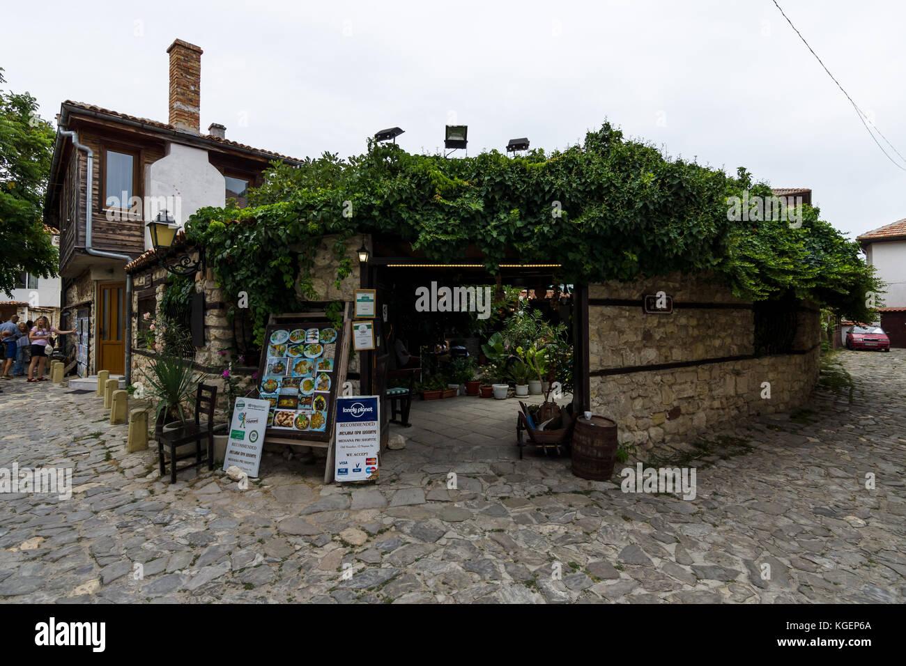 NESEBAR, BULGARIA - AUGUST 21, 2017: Typical restaurant in the UNESCO World Heritage town of Nesebar. Nesebar is Stock Photo