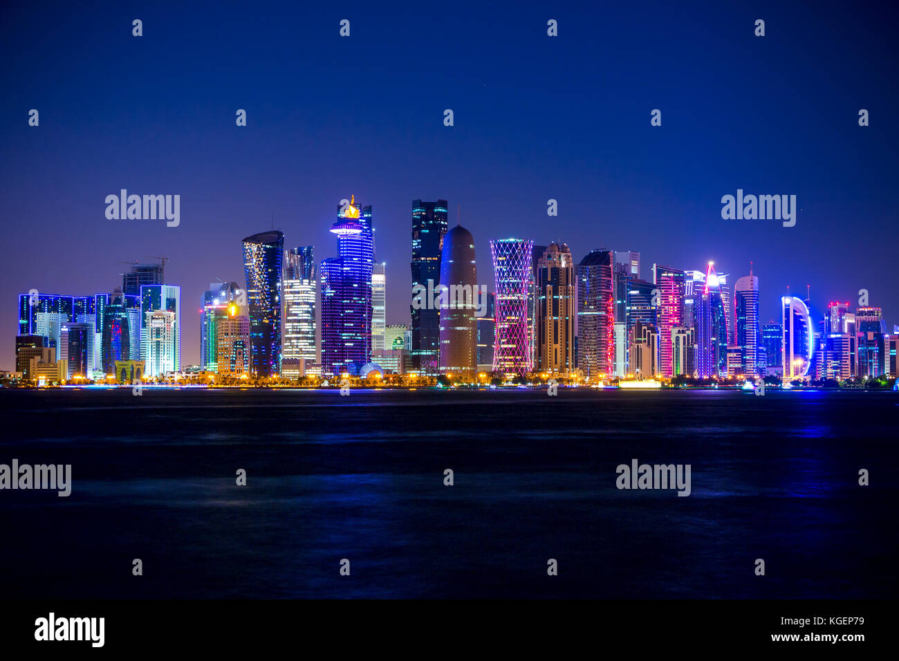 Qatar. Doha skyscrapers with external lighting. Cloudless sky and night Stock Photo