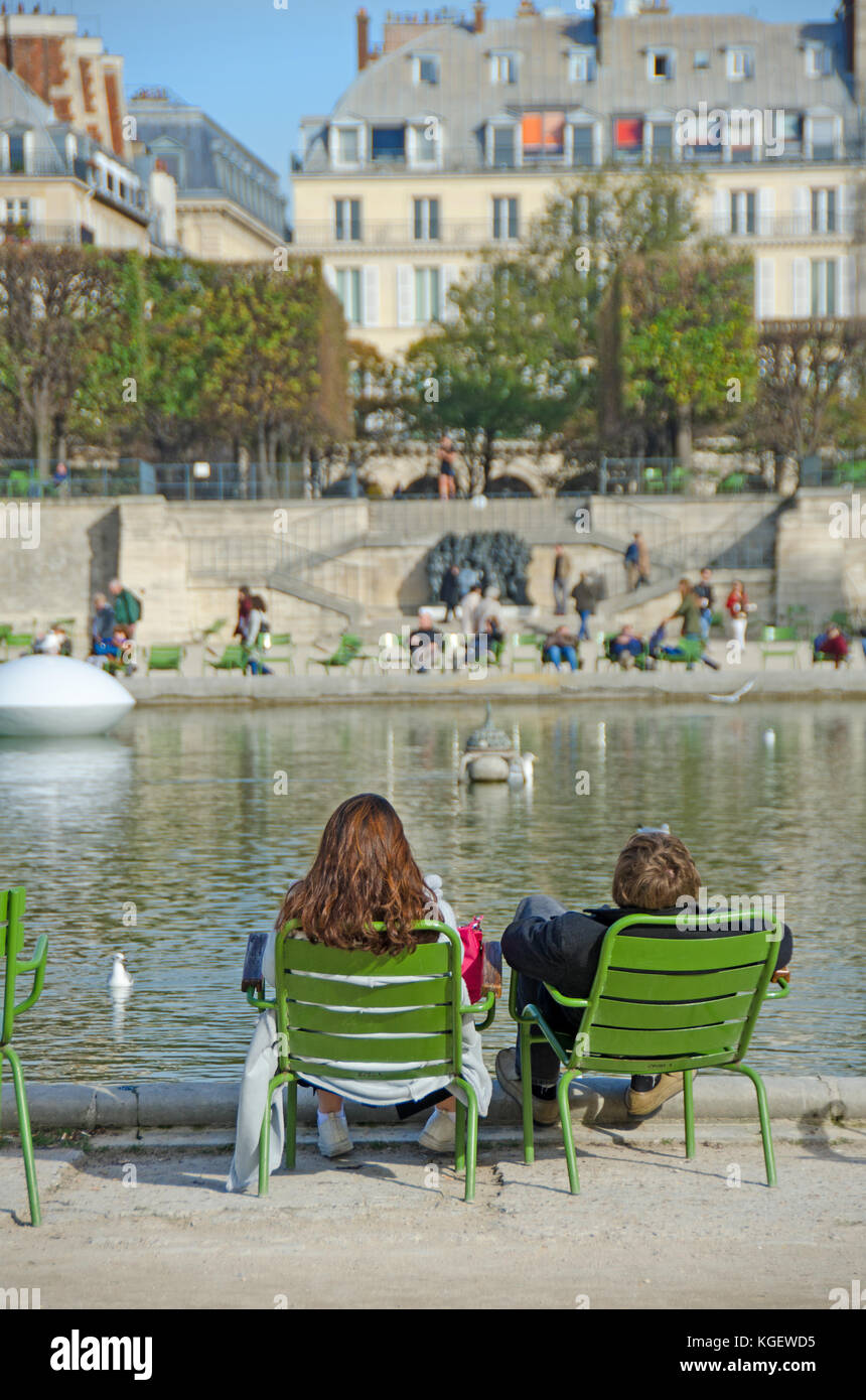 Paris, France. Jardin des Tuileries. Autumn - people relaxing around the Bassin Octagonal (pond) - Stock Image